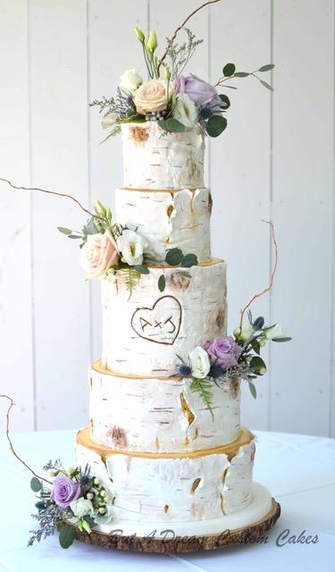White rustic birch wedding cake with sugar flowers