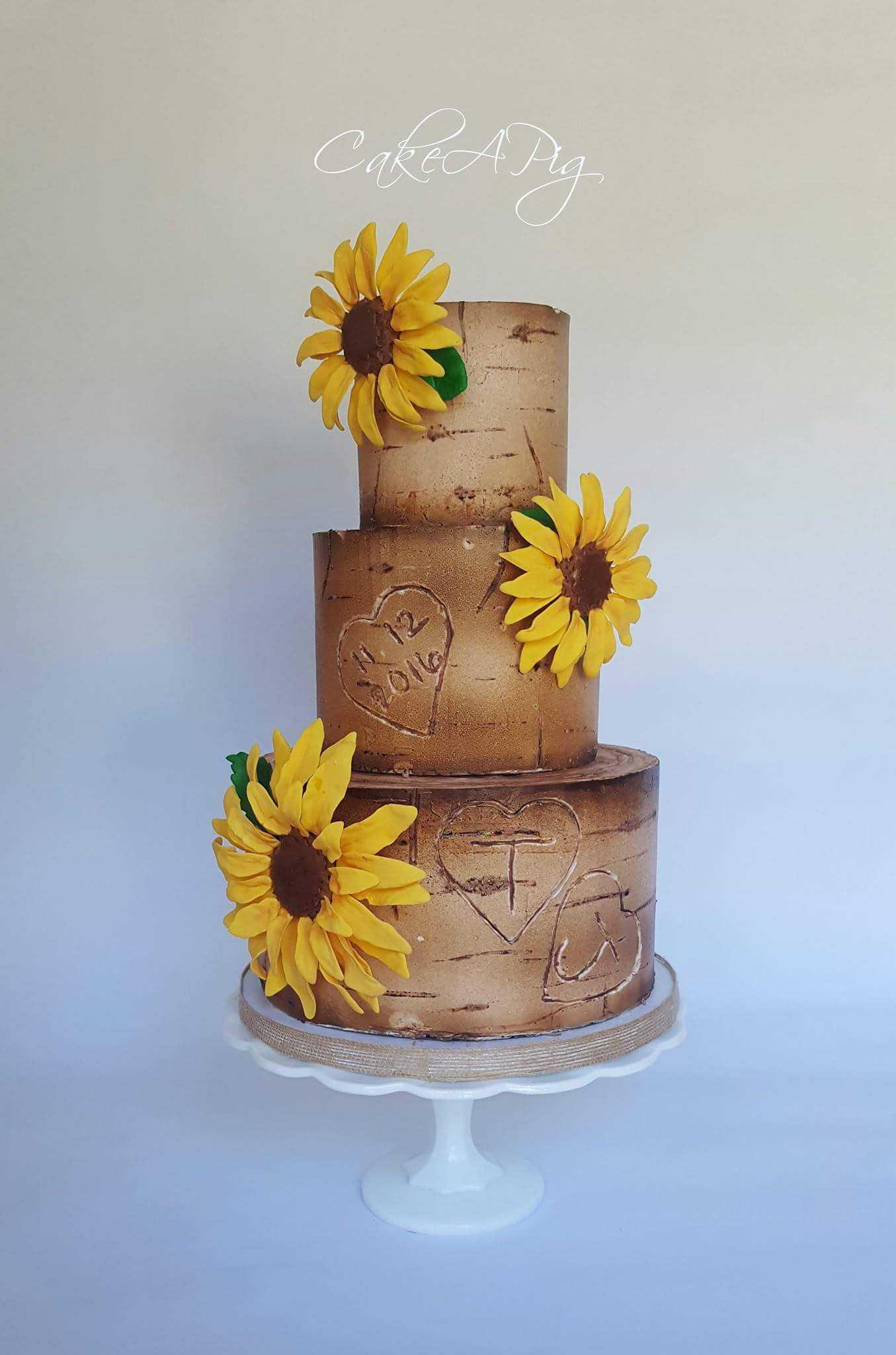 Brown rustic bark wedding cake with sugar sun flowers