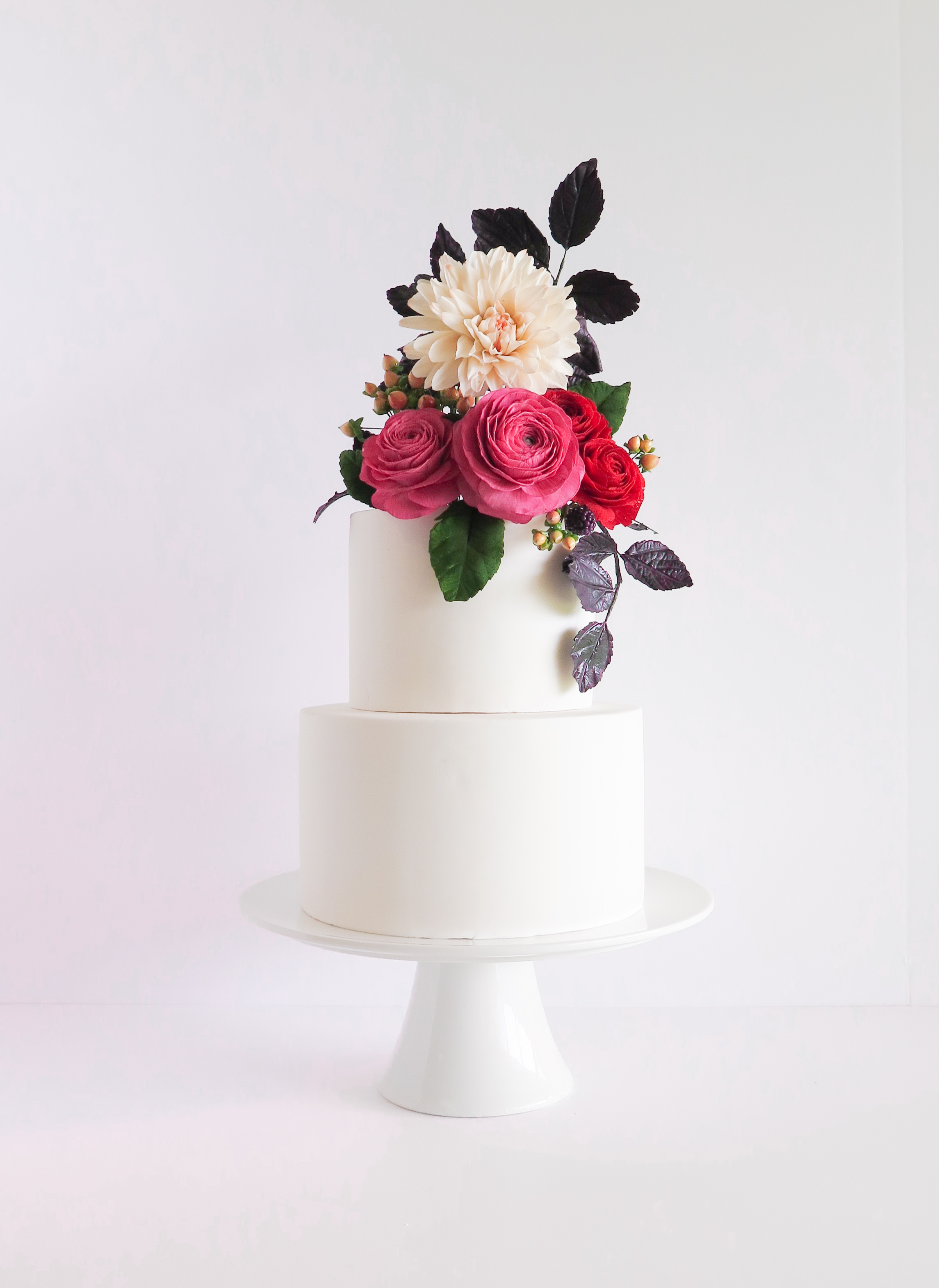 White wedding with pink sugar flower bouquet on top