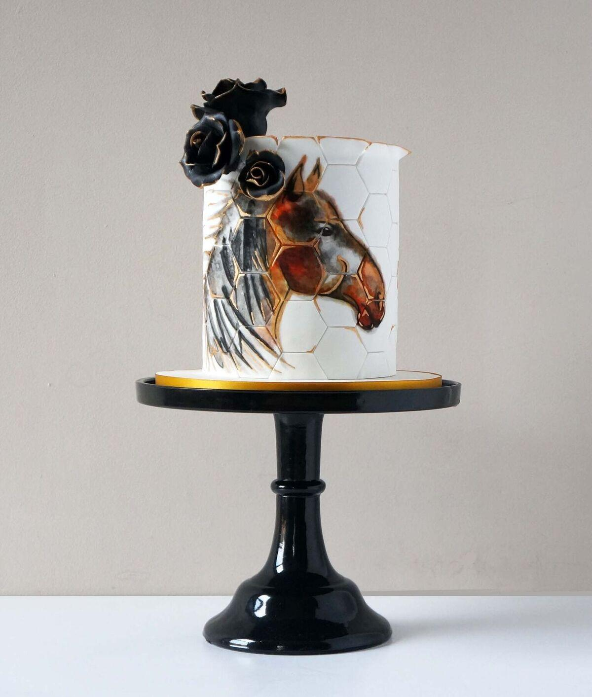 White geometric cake with hand painted horse