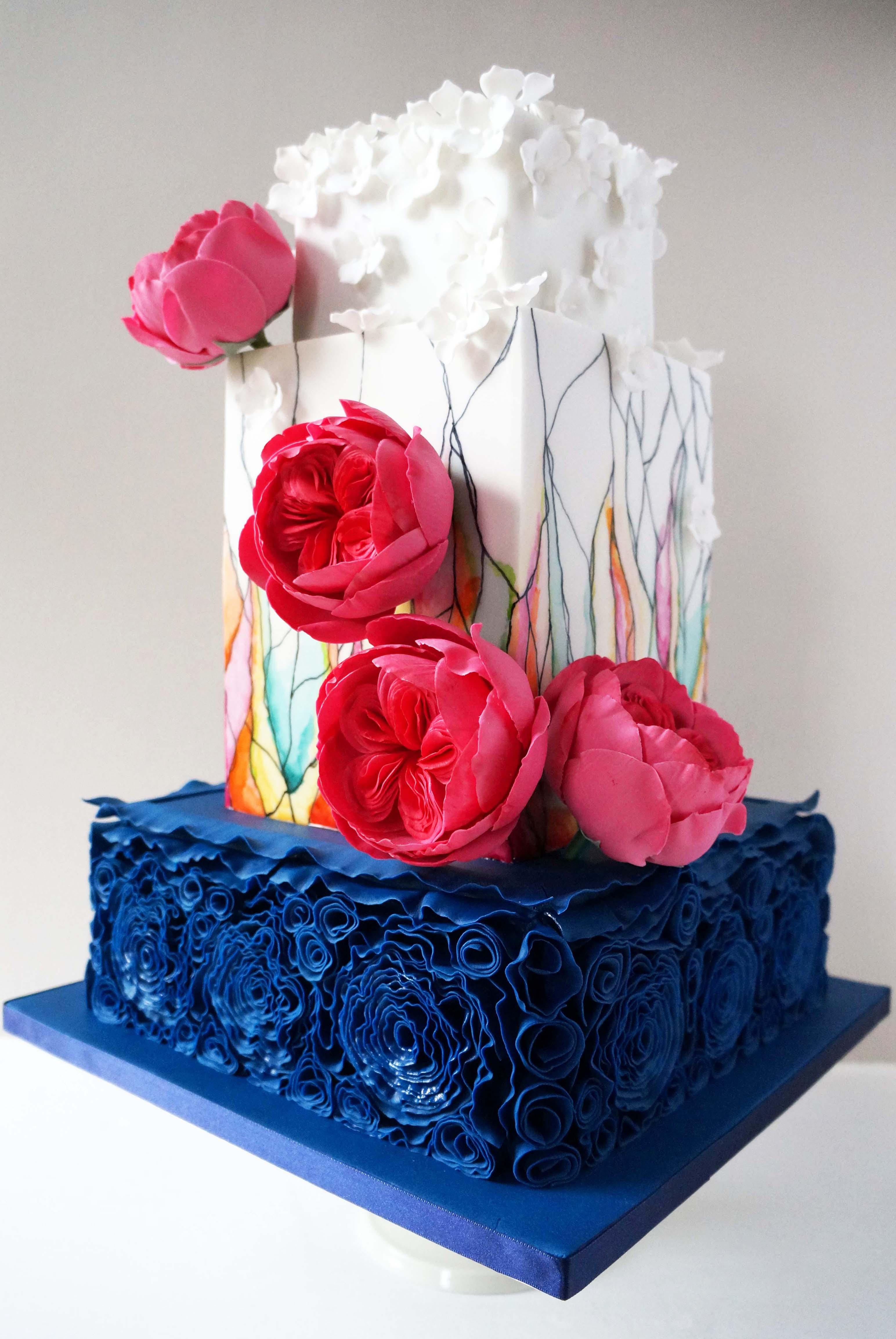 White with blue rosettes square wedding cake