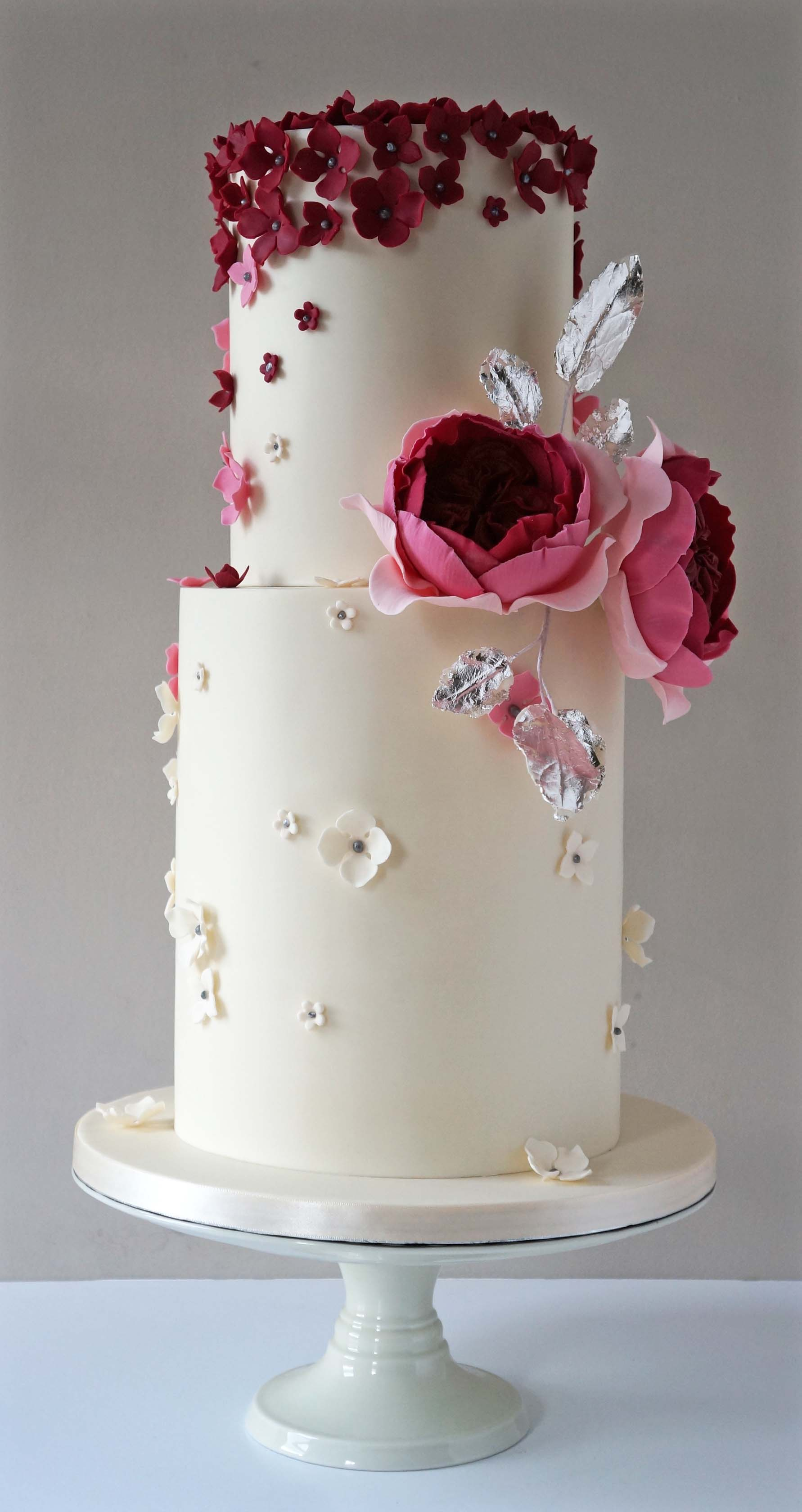 White wedding cake with little red flowers