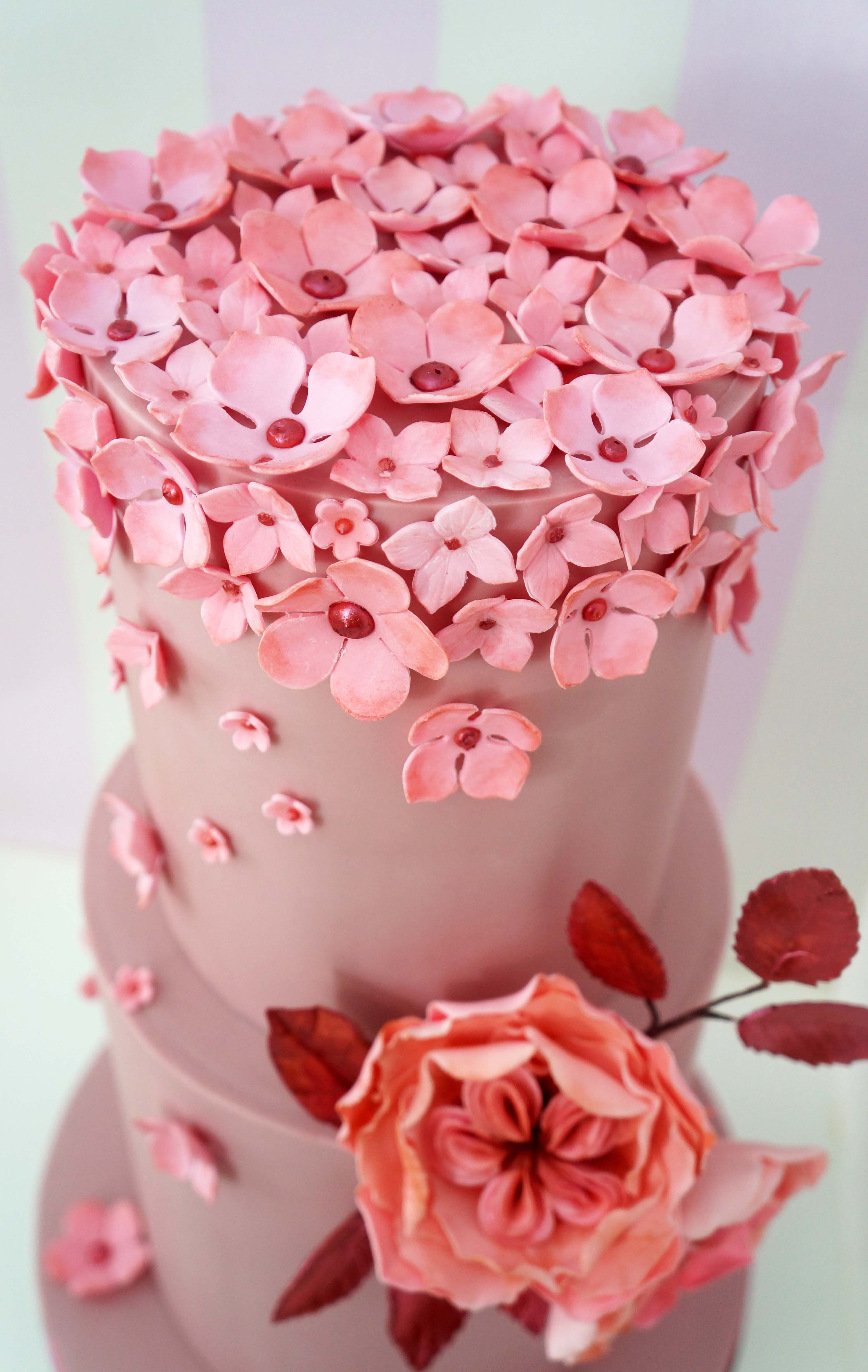 Pink Wedding cake with small pink flowers