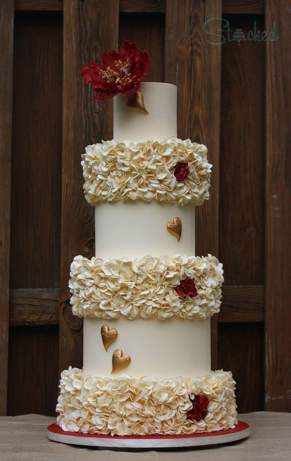 Ivory ruffle wedding cake with hearts