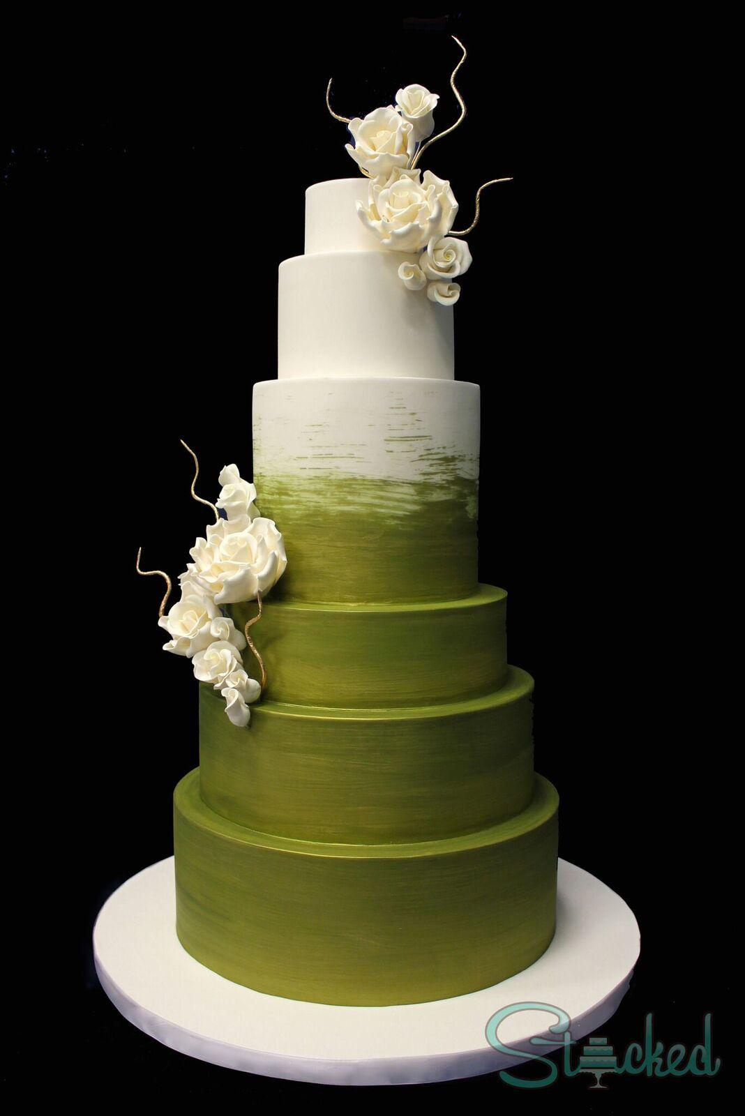 White and green hand painted wedding cake with sugar flowers