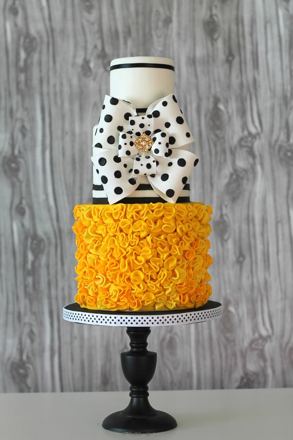 Orange Ruffle & Bow Wedding Cake