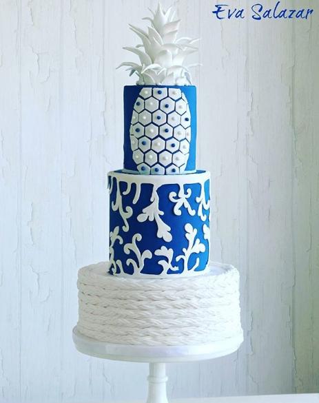 Bright blue and white wedding resort themed wedding cake