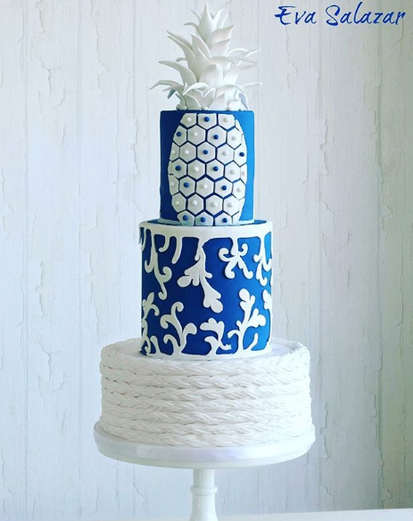 Bright blue and white wedding resort themed wedding cake