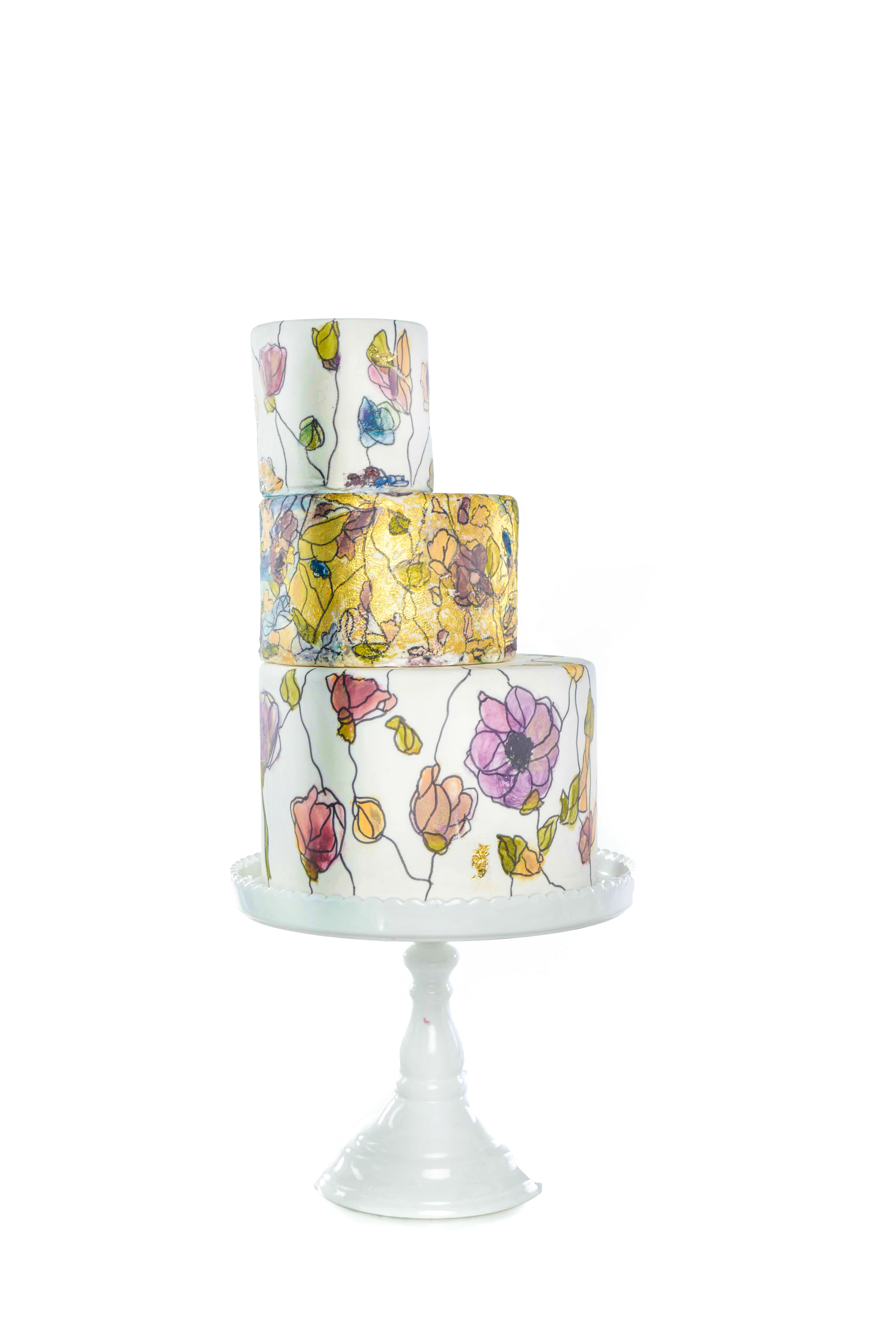 Handpainted flower wedding cake with gold sparkle