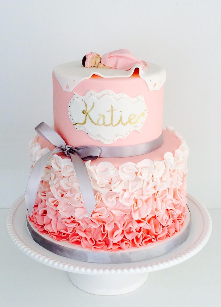 Pink and white ruffle baby shower cake