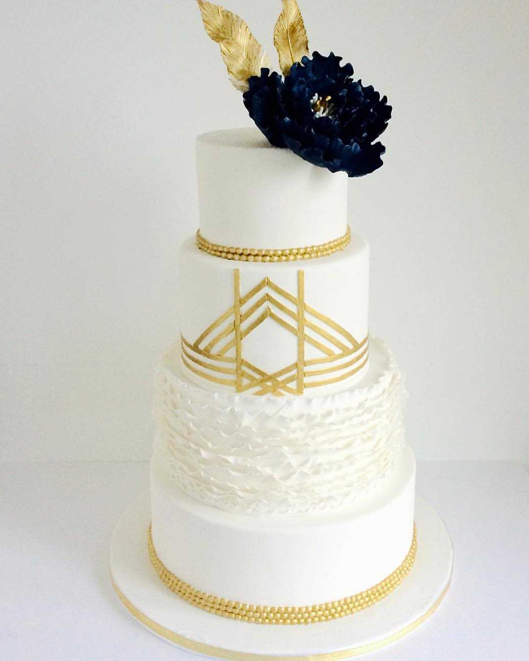 Great Gatsby inspired wedding cake with ruffles, gold pearls and open blue sugar peony