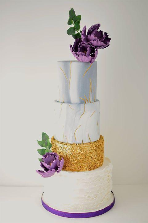 Silver and white marbled wedding cake with gold sequins and purple sugar peonies