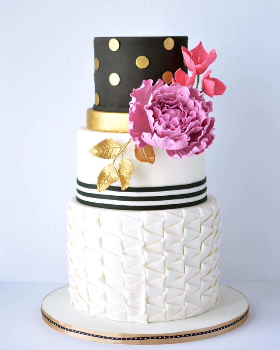 Black with gold polka got and white wedding cake