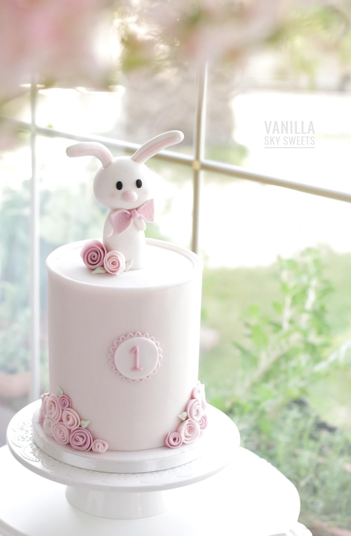 Light pink fondant first birthday bunny cake