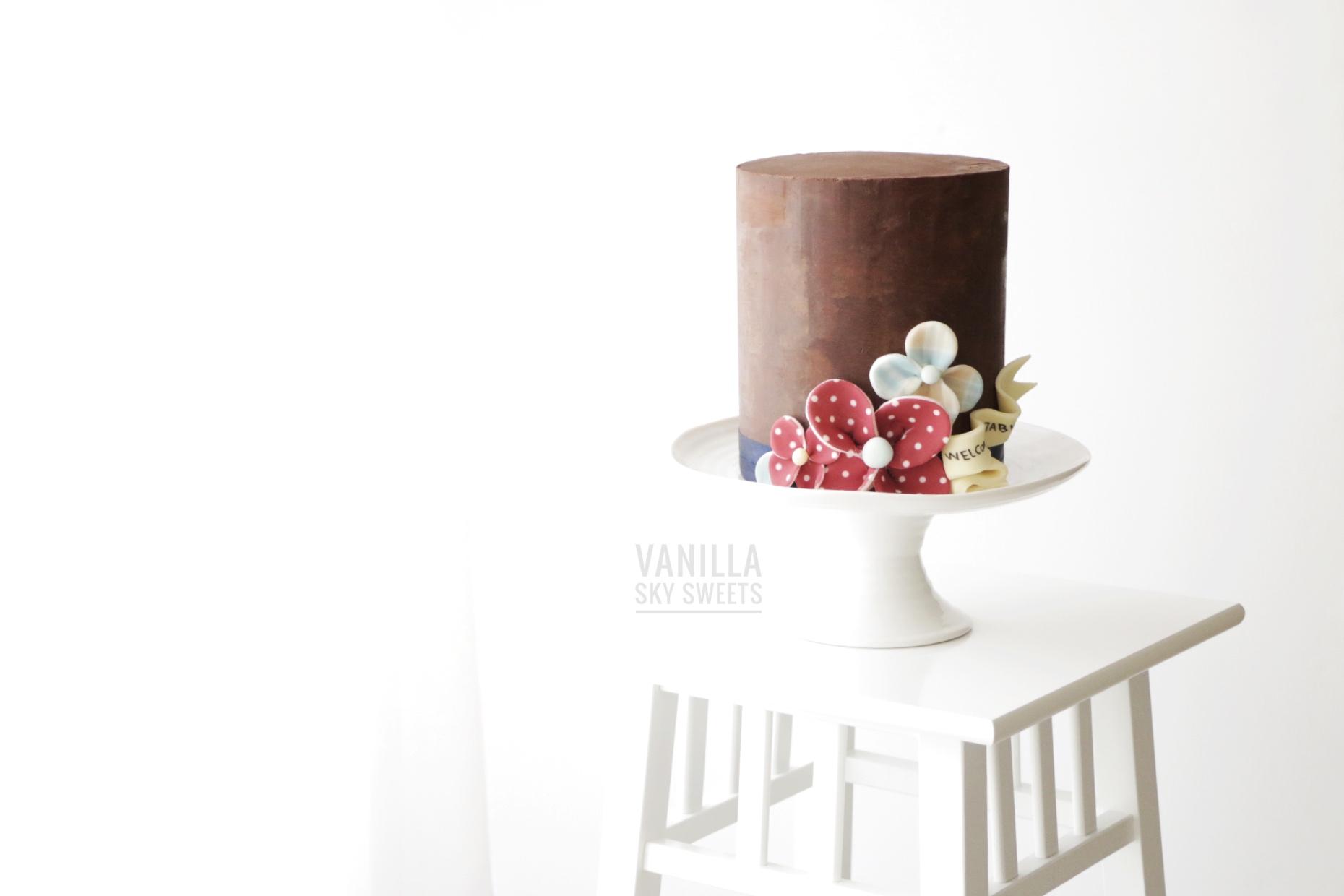 Chocolate mini cake with red fondant pinwheels