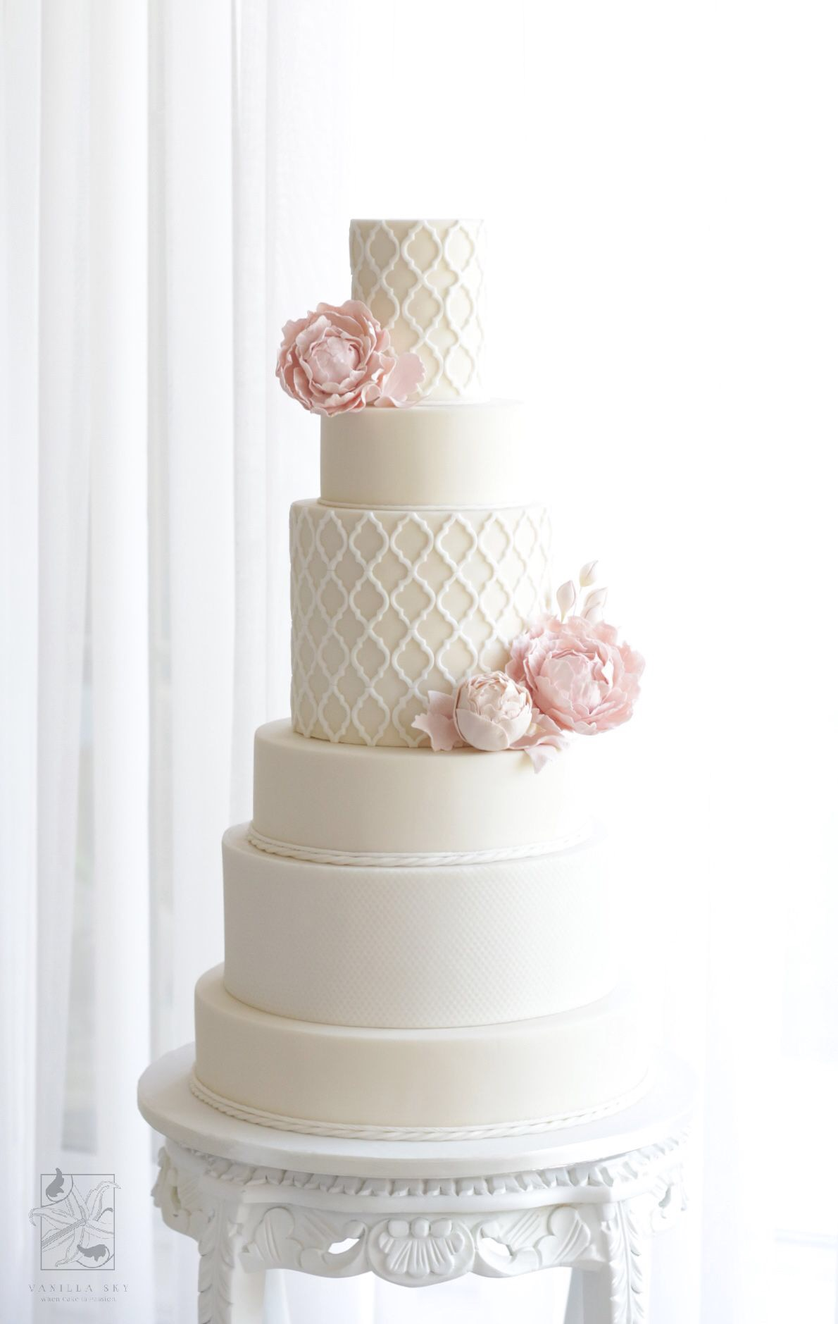 Ivory wedding cake with light pink sugar roses