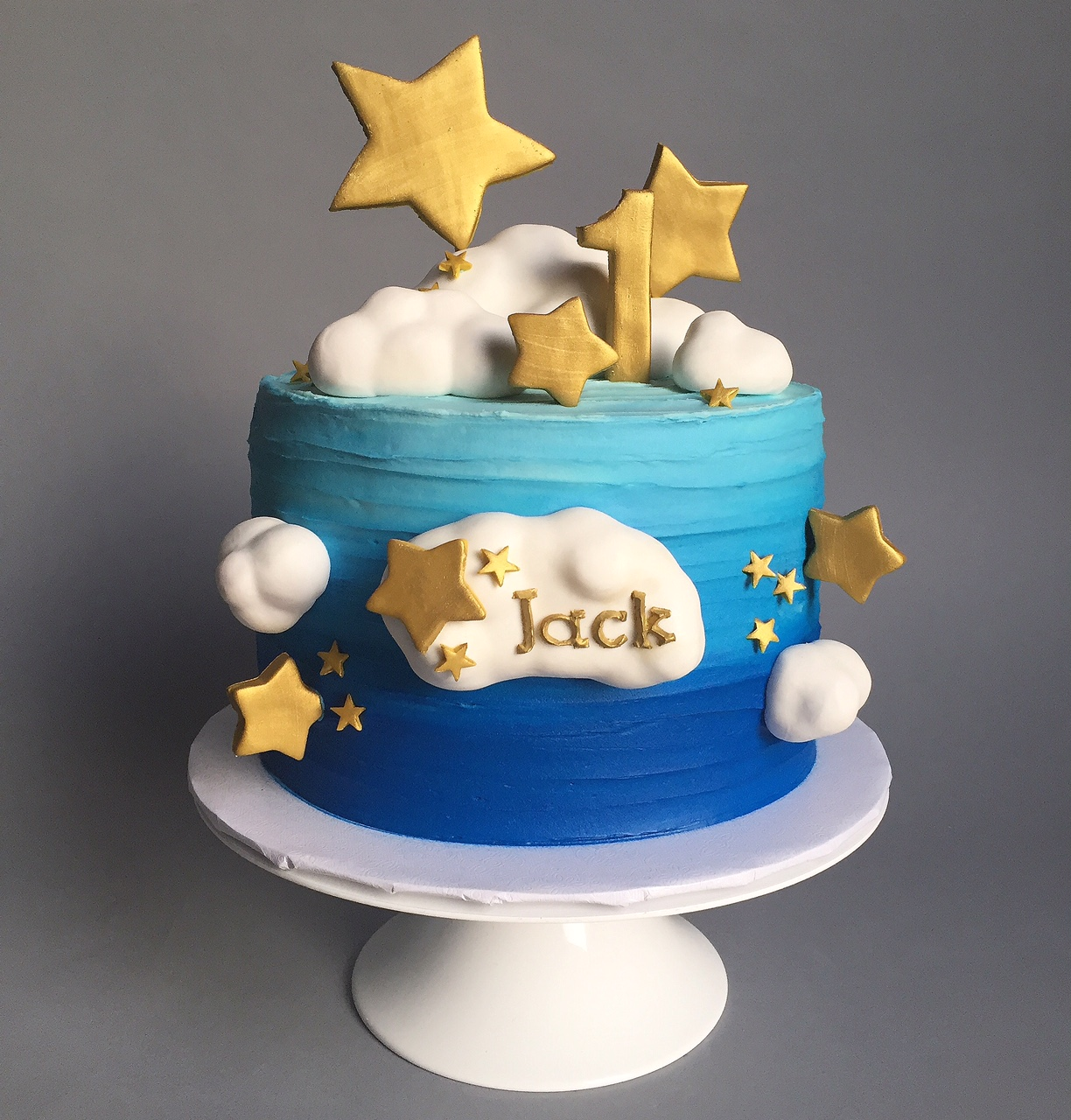 Gold star and clouds first birthday cake