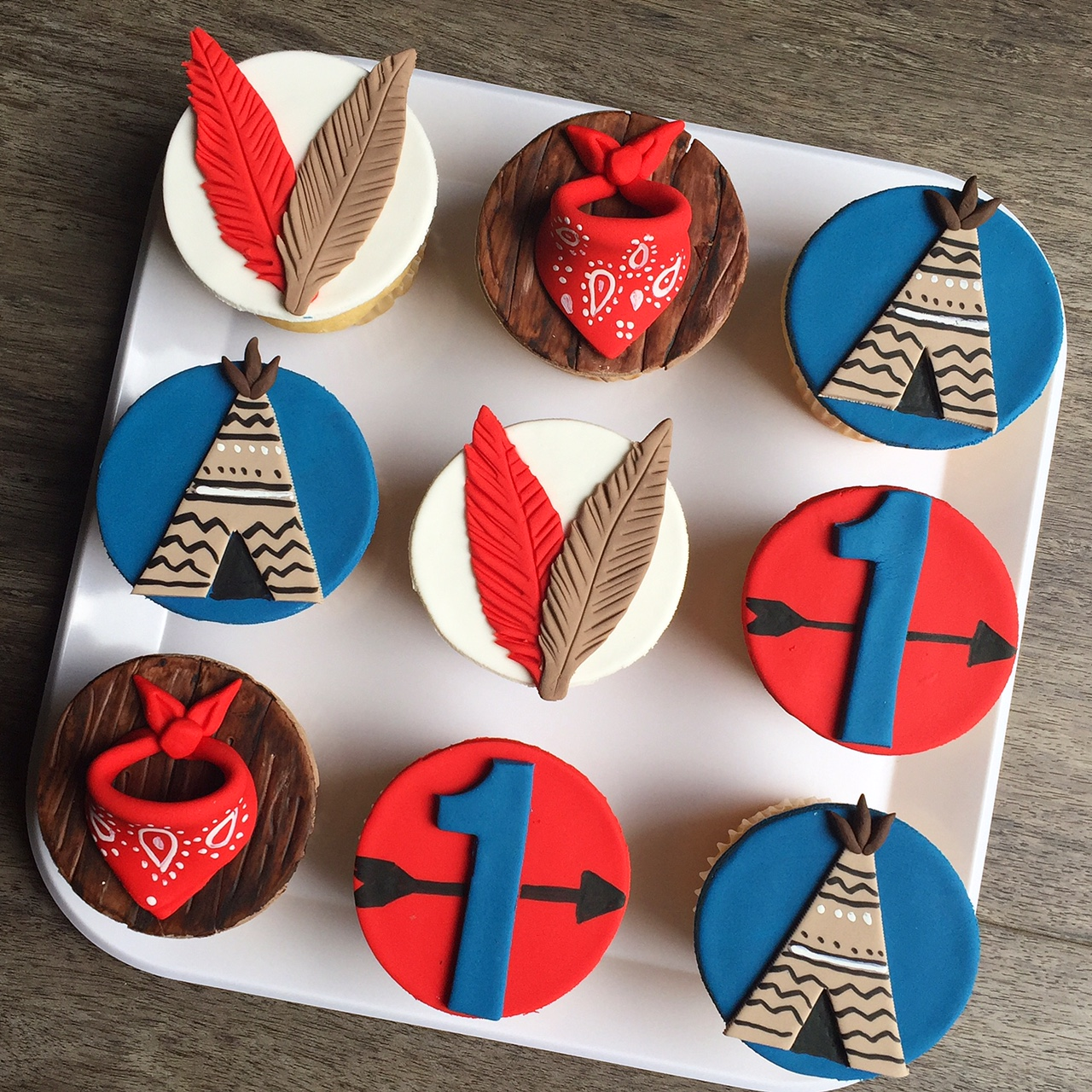 Indian feather boho and camping themed cupcakes