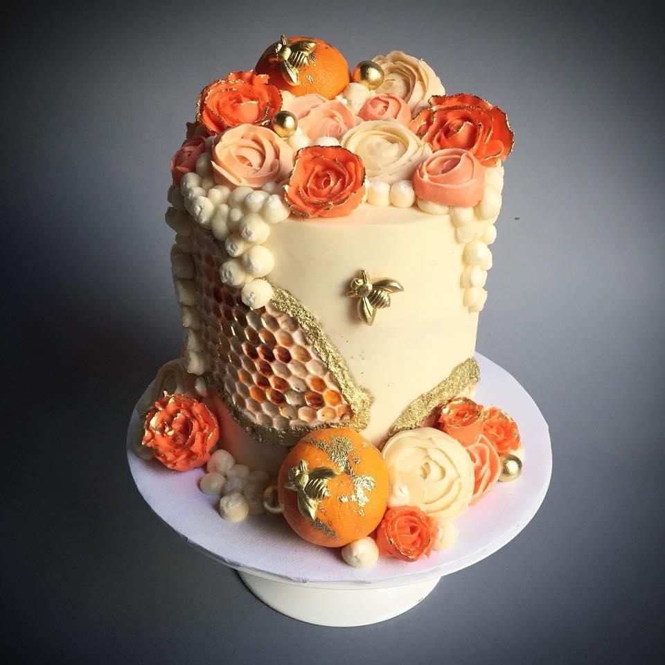 Orange and ivory honeycomb patterned wedding cake