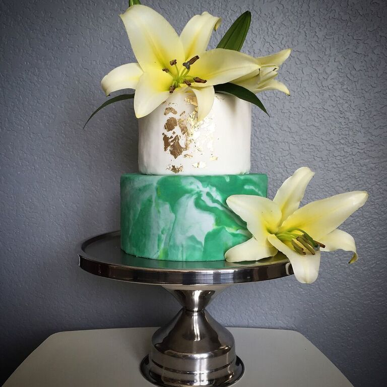 Green and white marl be wedding cake with sugar lilies