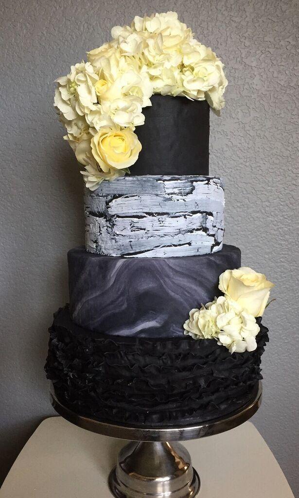 Black marble wedding cake with white sugar roses