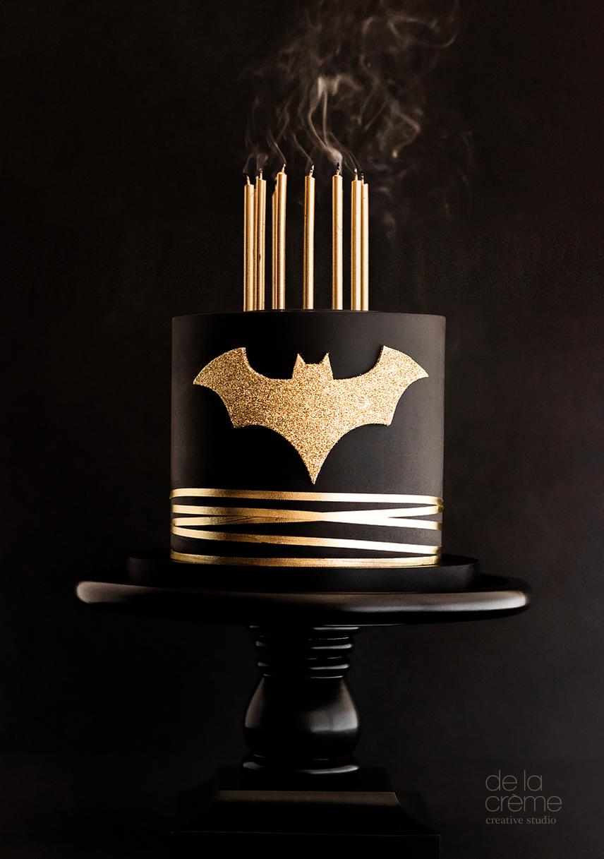 Black and gold glamorous batman themed cake