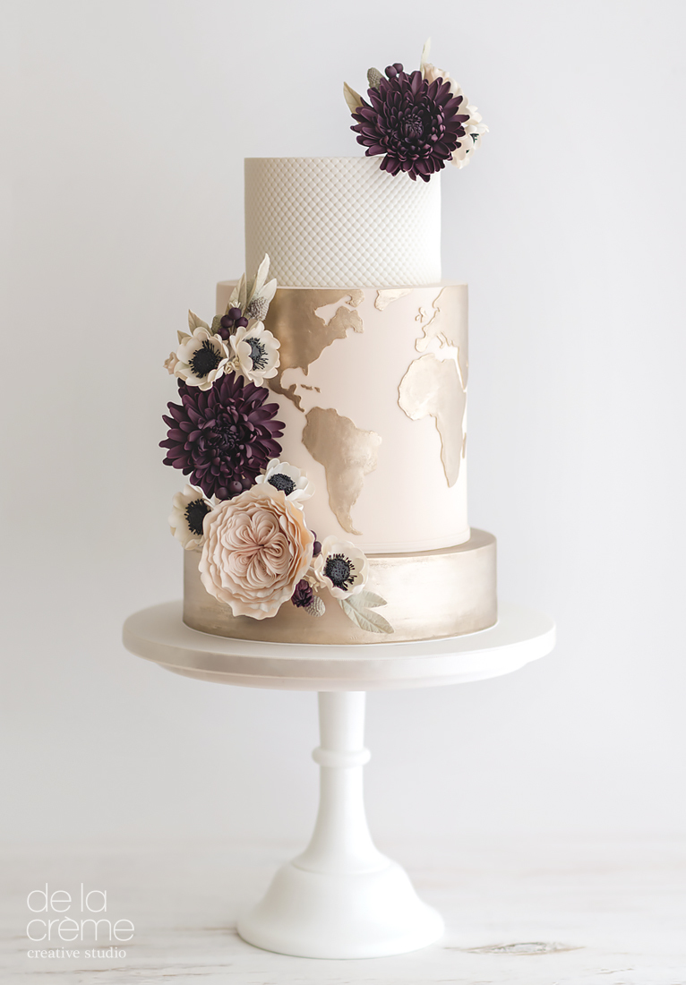 Light pink and gold travel themed wedding cake