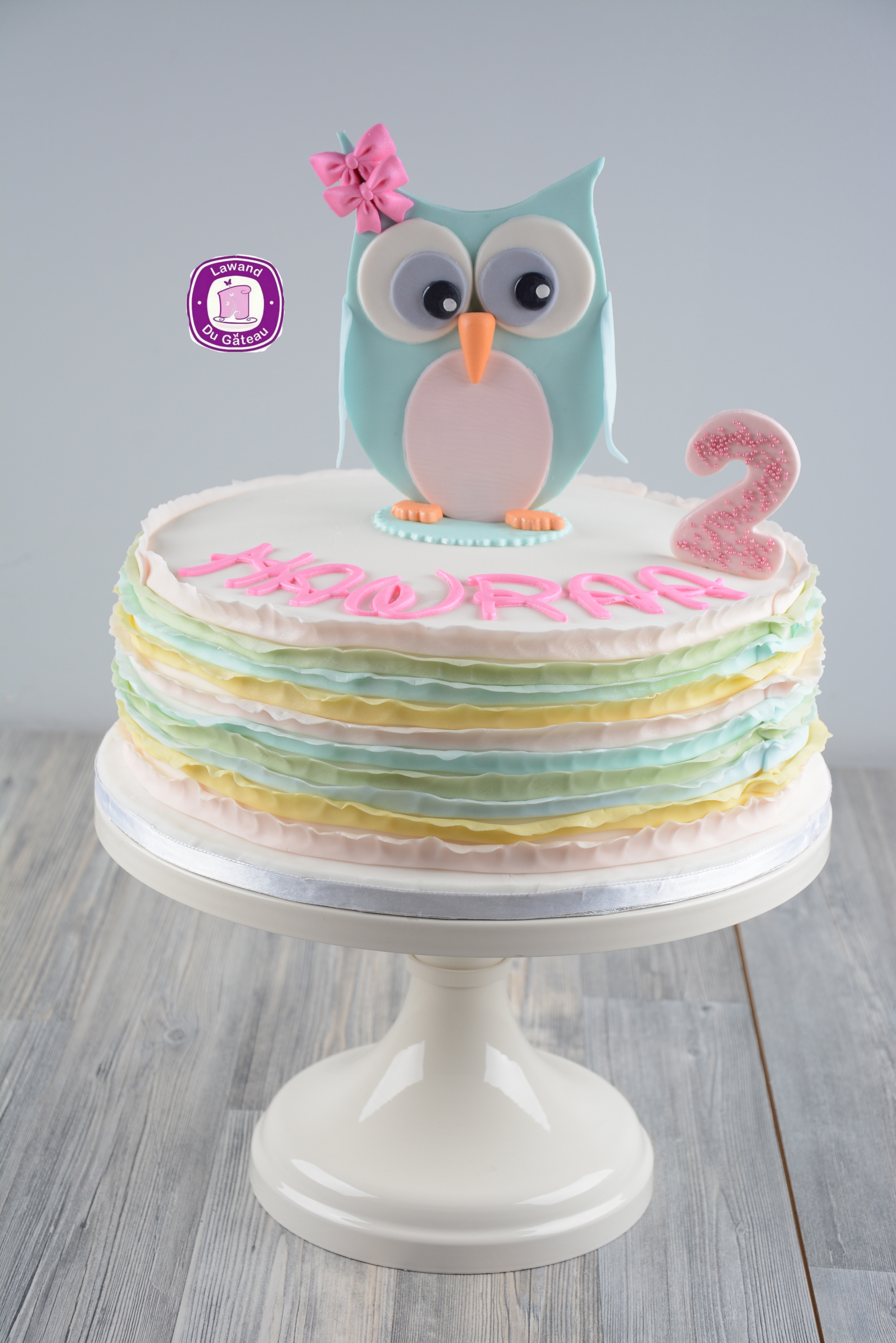 Pastel ombre ruffle owl themed birthday cake