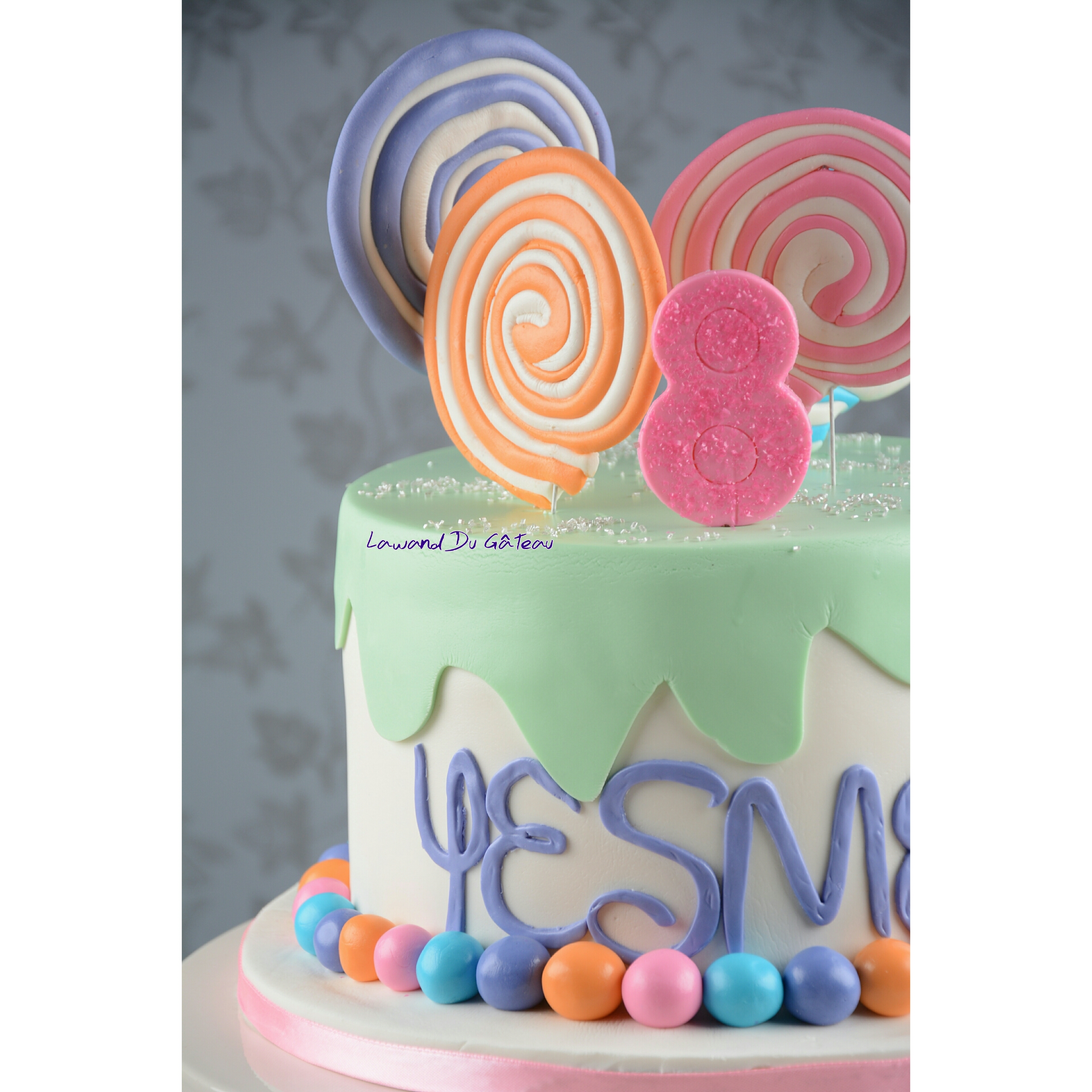 Pastel colored lollipop birthday cake