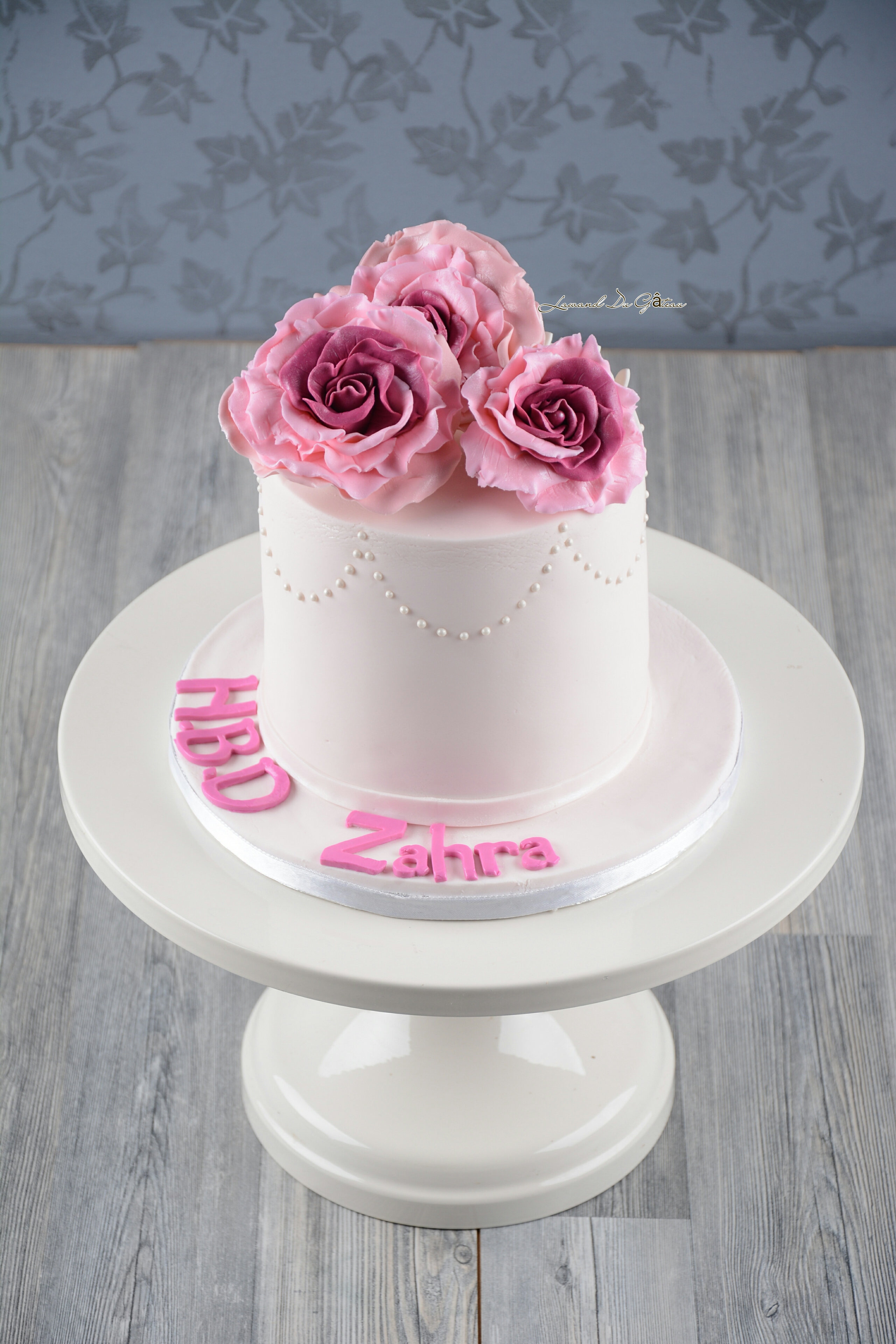 Mini white cake with pink sugar roses