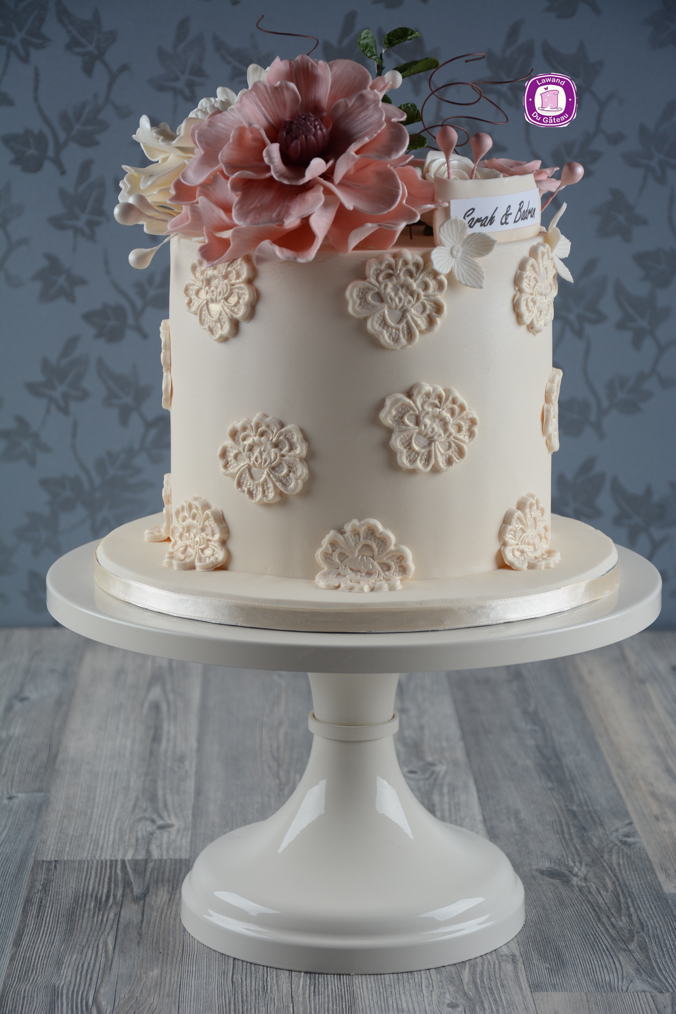 White and light pink wedding cake