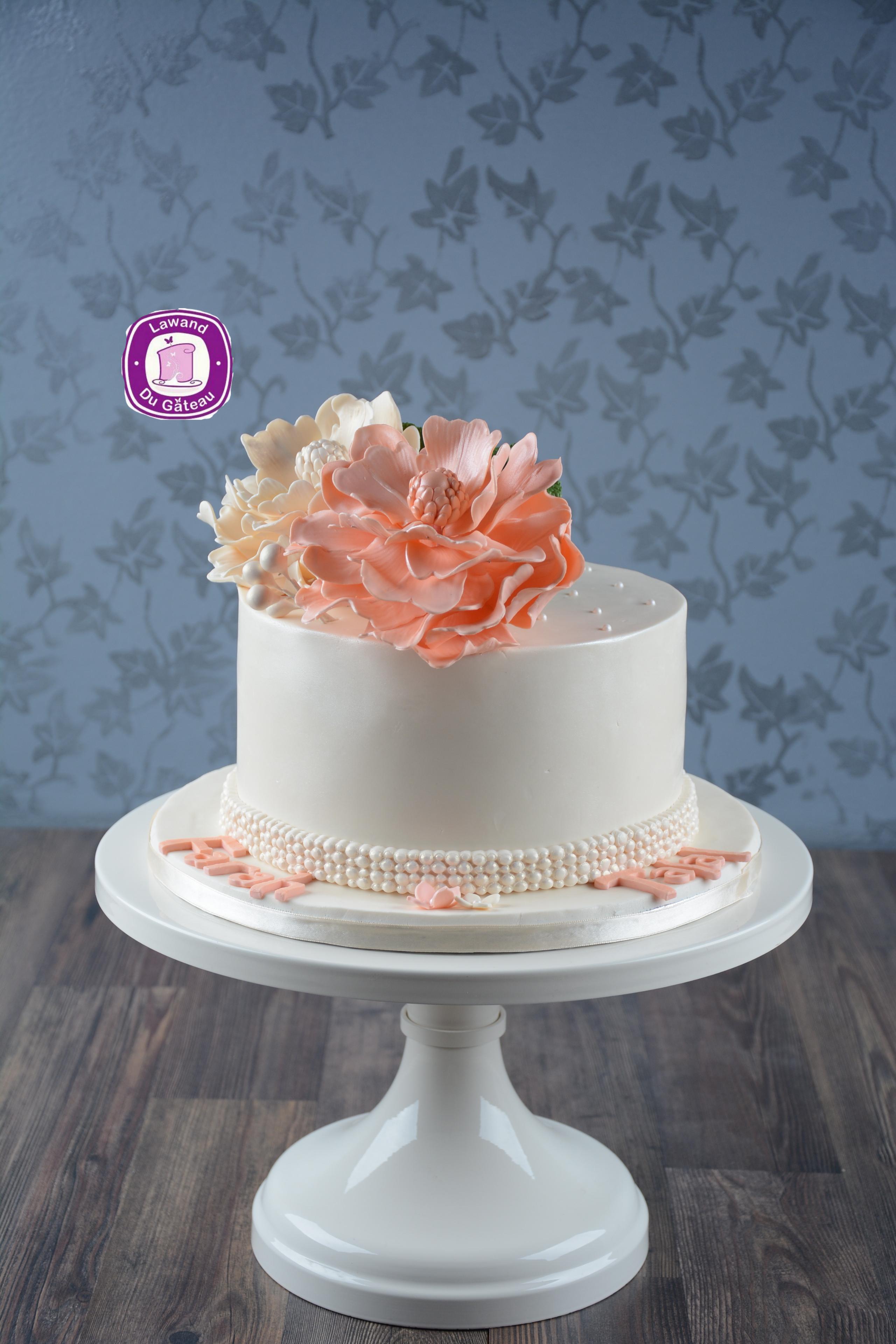 White mini cake with peach sugar flowers