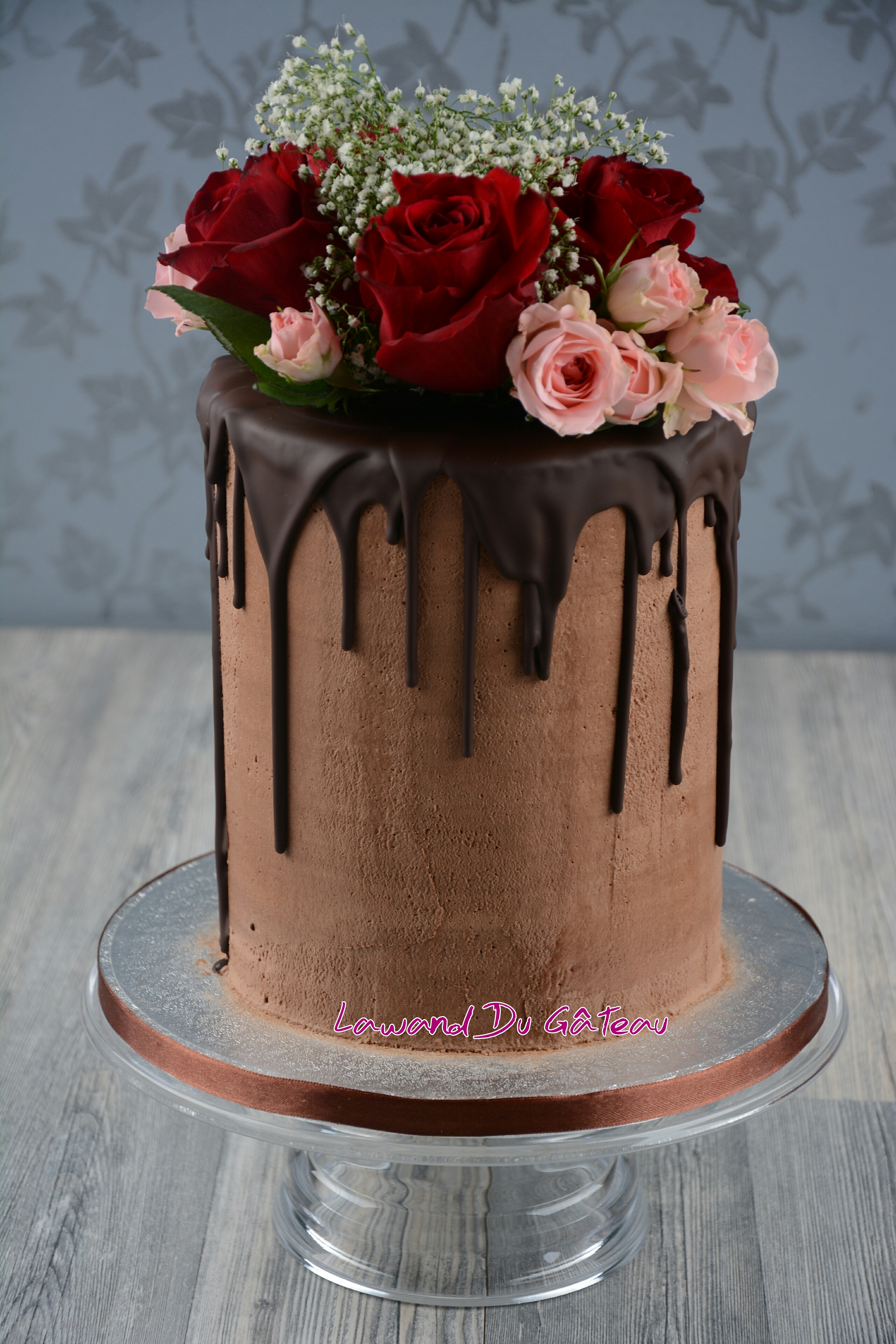 Chocolate colored drip wedding cake with sugar flowers