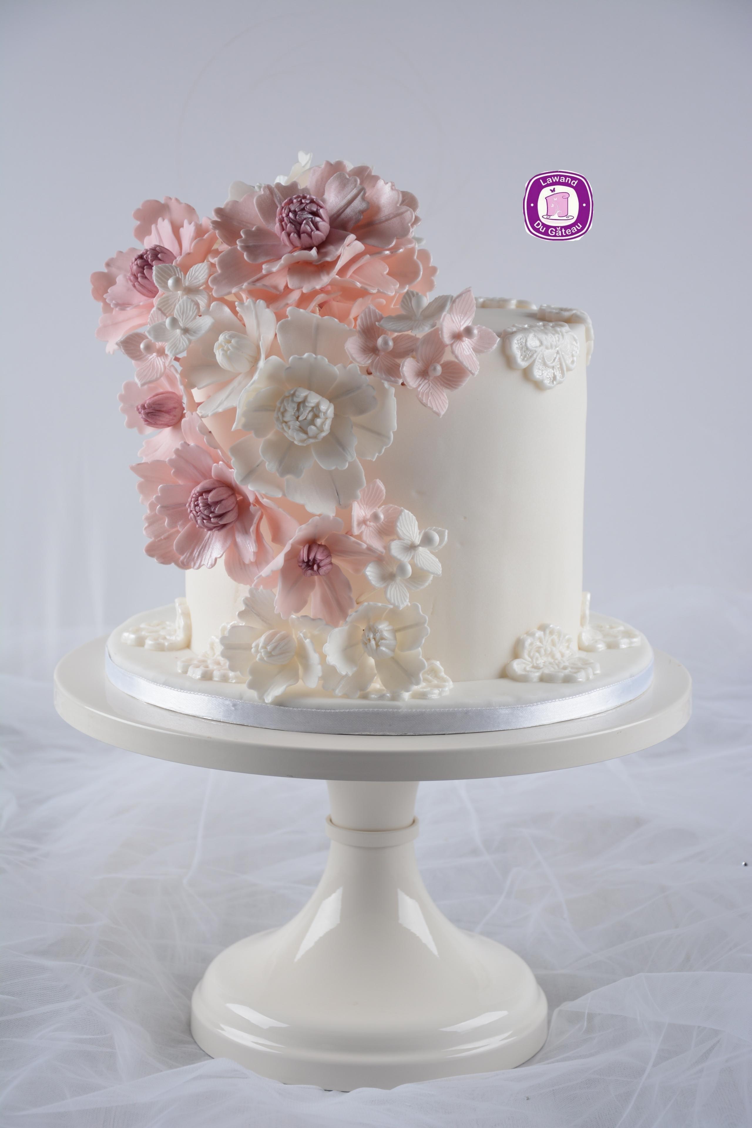 Mini ivory wedding cake with pink sugar flowers