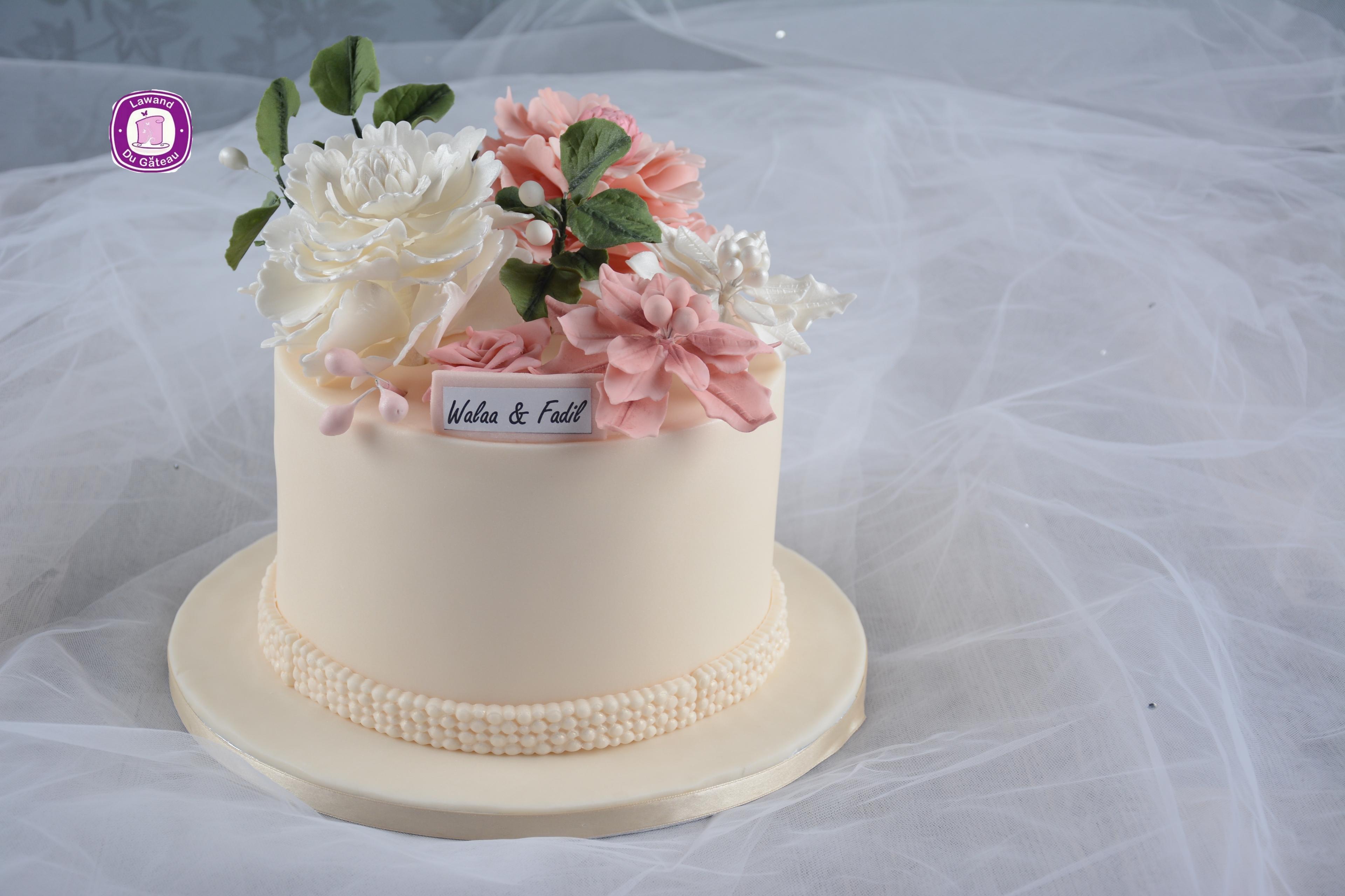 Mini ivory wedding cake with sugar flowers
