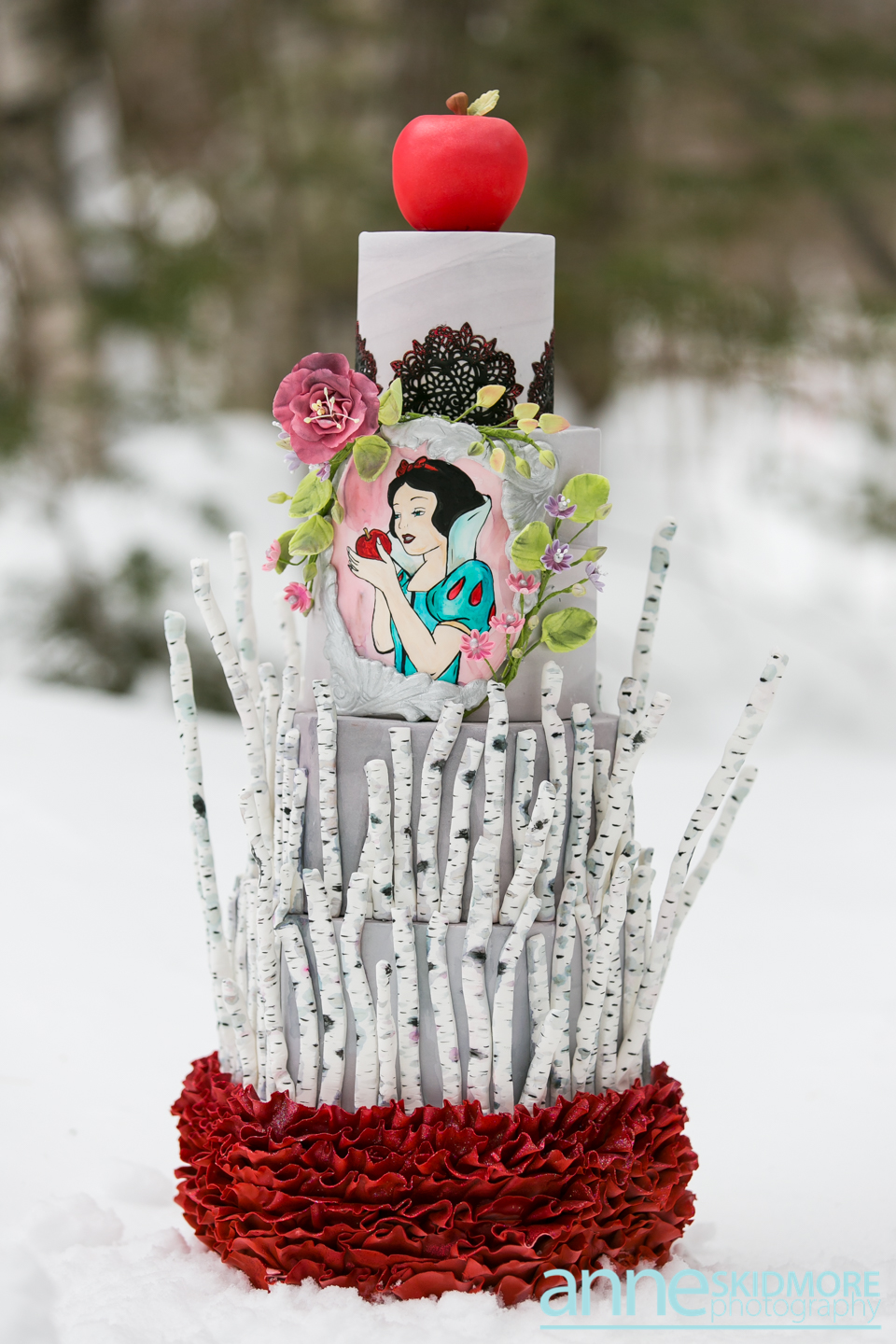 White and red snow white themed wedding cake