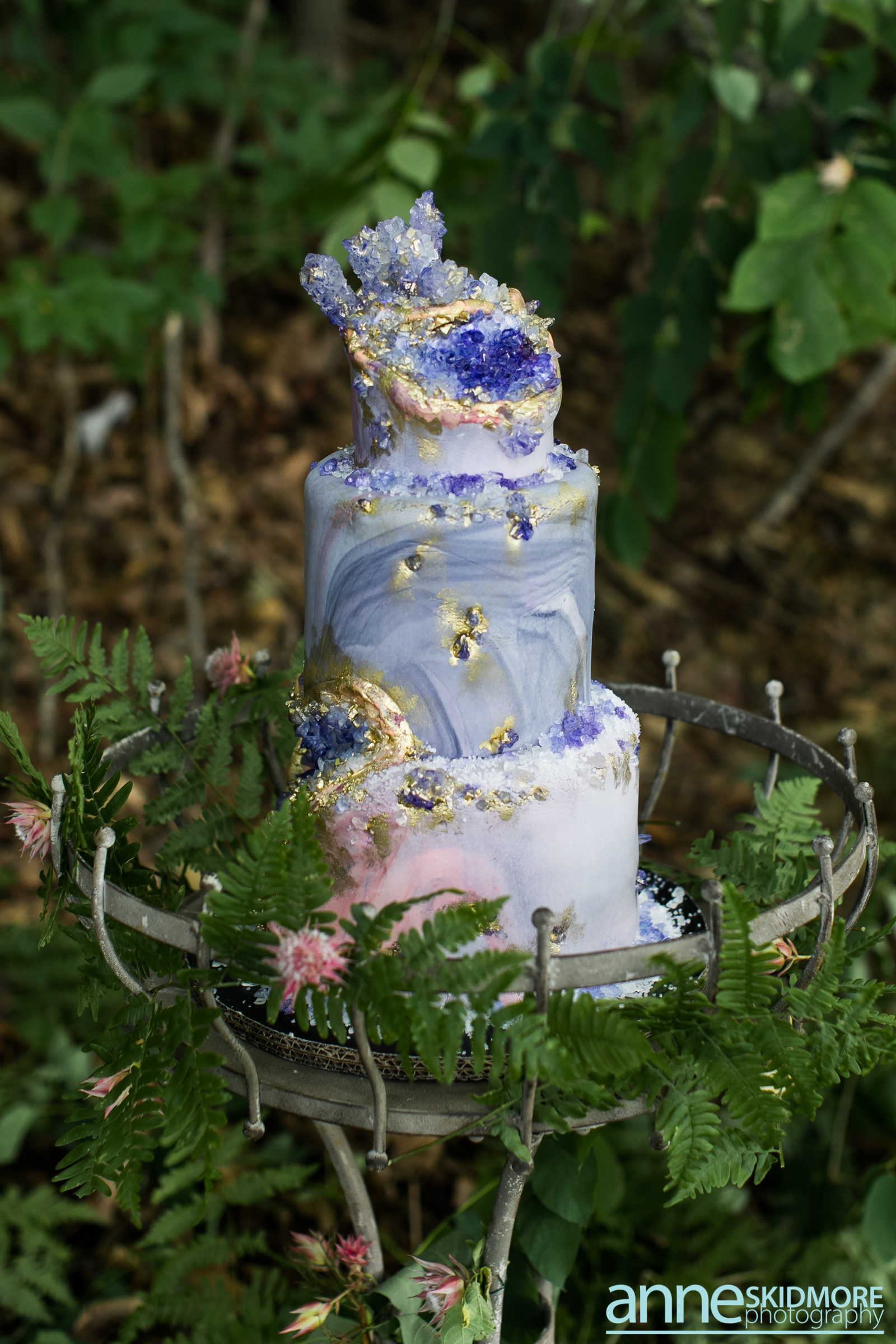 Blue marbled rock geode wedding cake with gold accents