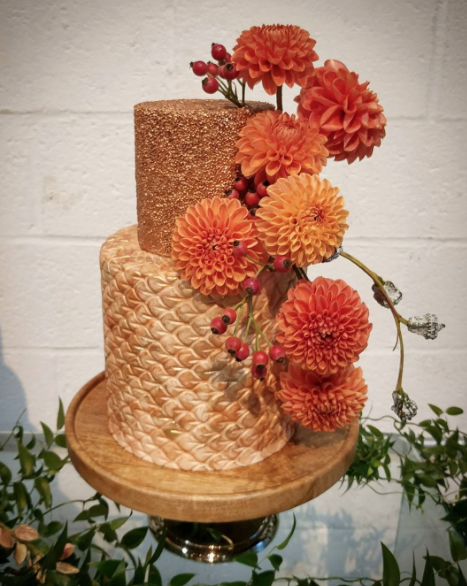Burnt Orange and gold wedding cake with sugar flowers