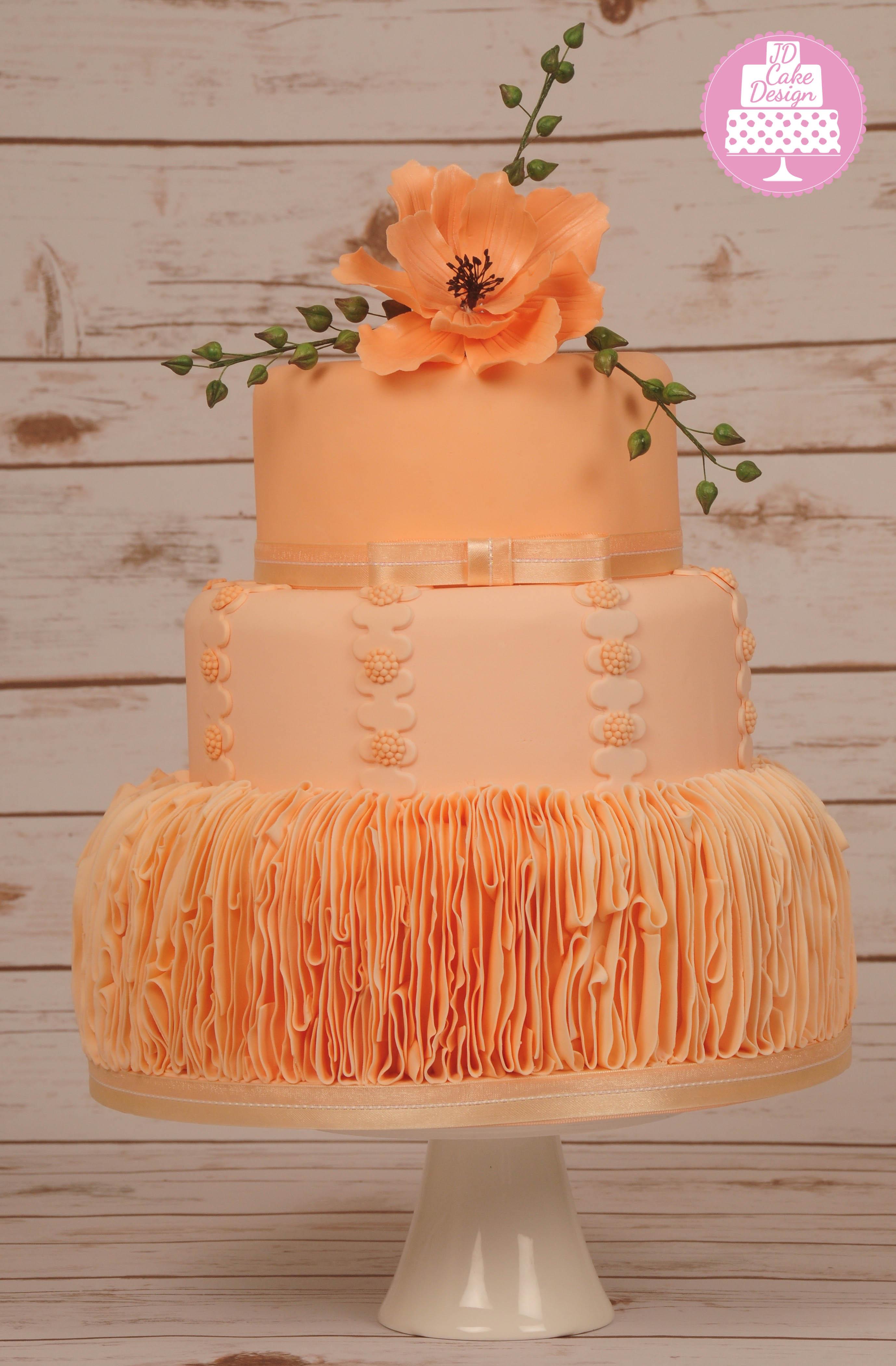 Orange ruffle wedding cake