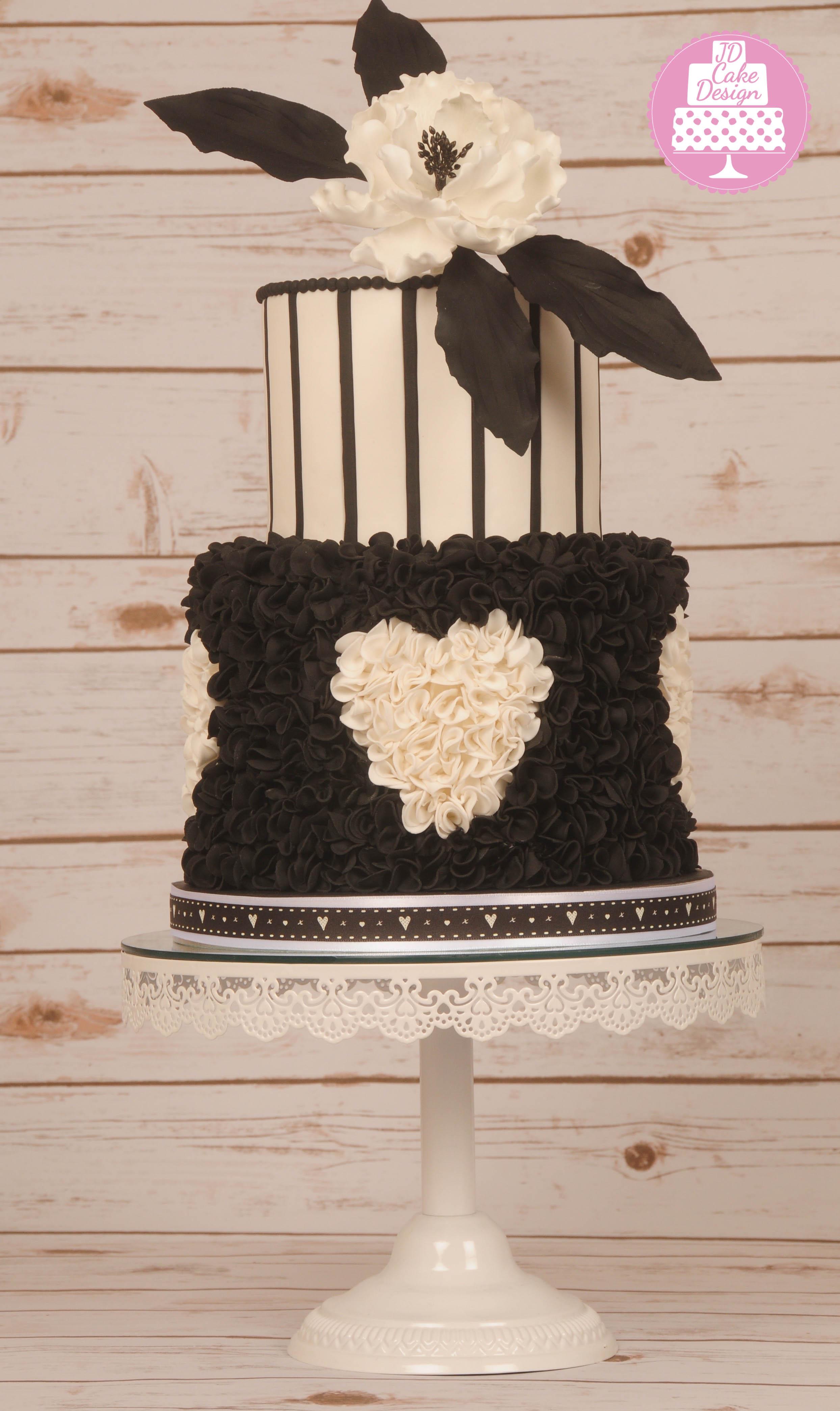 Black and white ruffle heart wedding cake