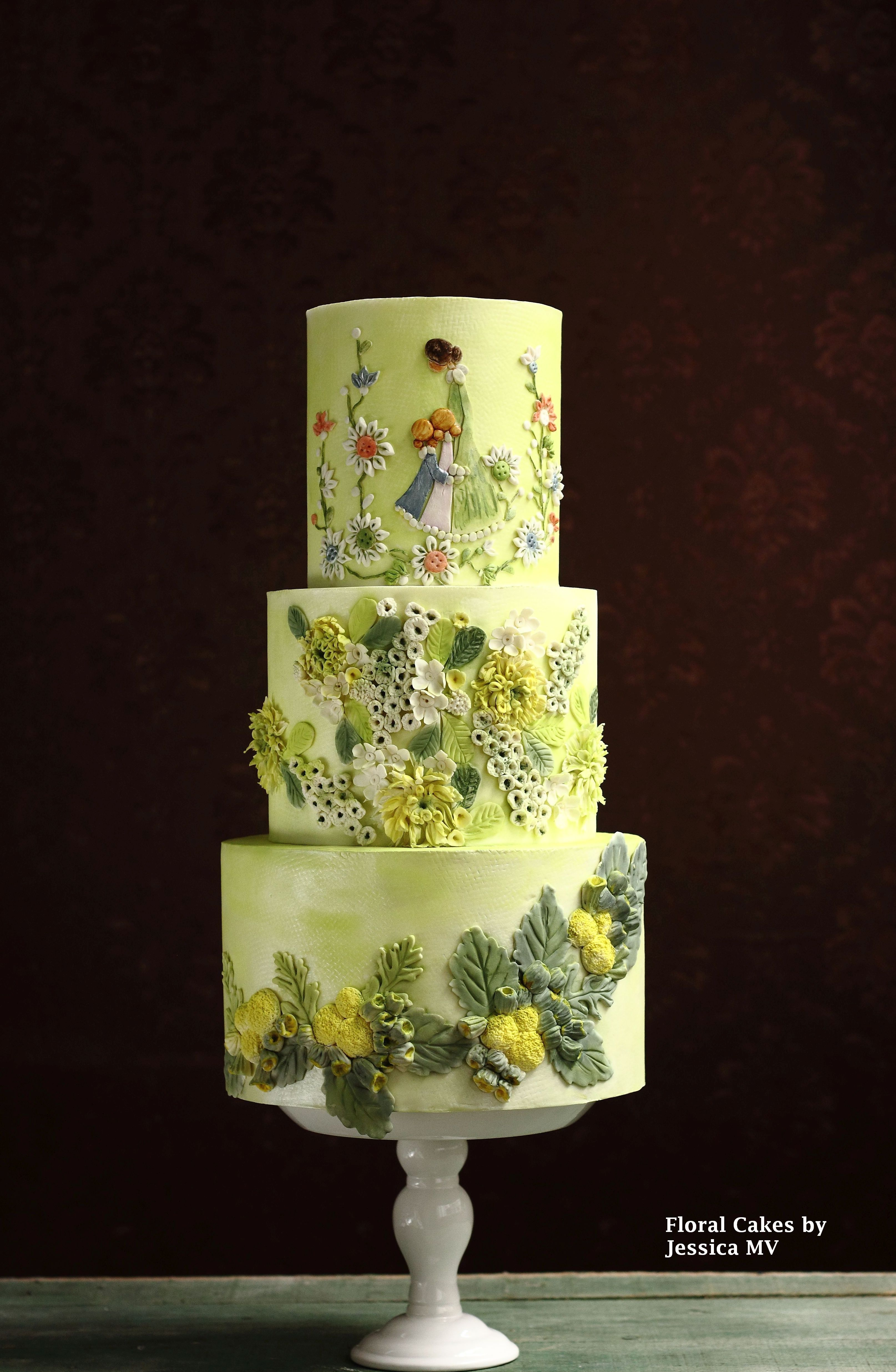 Pastel yellow wedding cake with green accents
