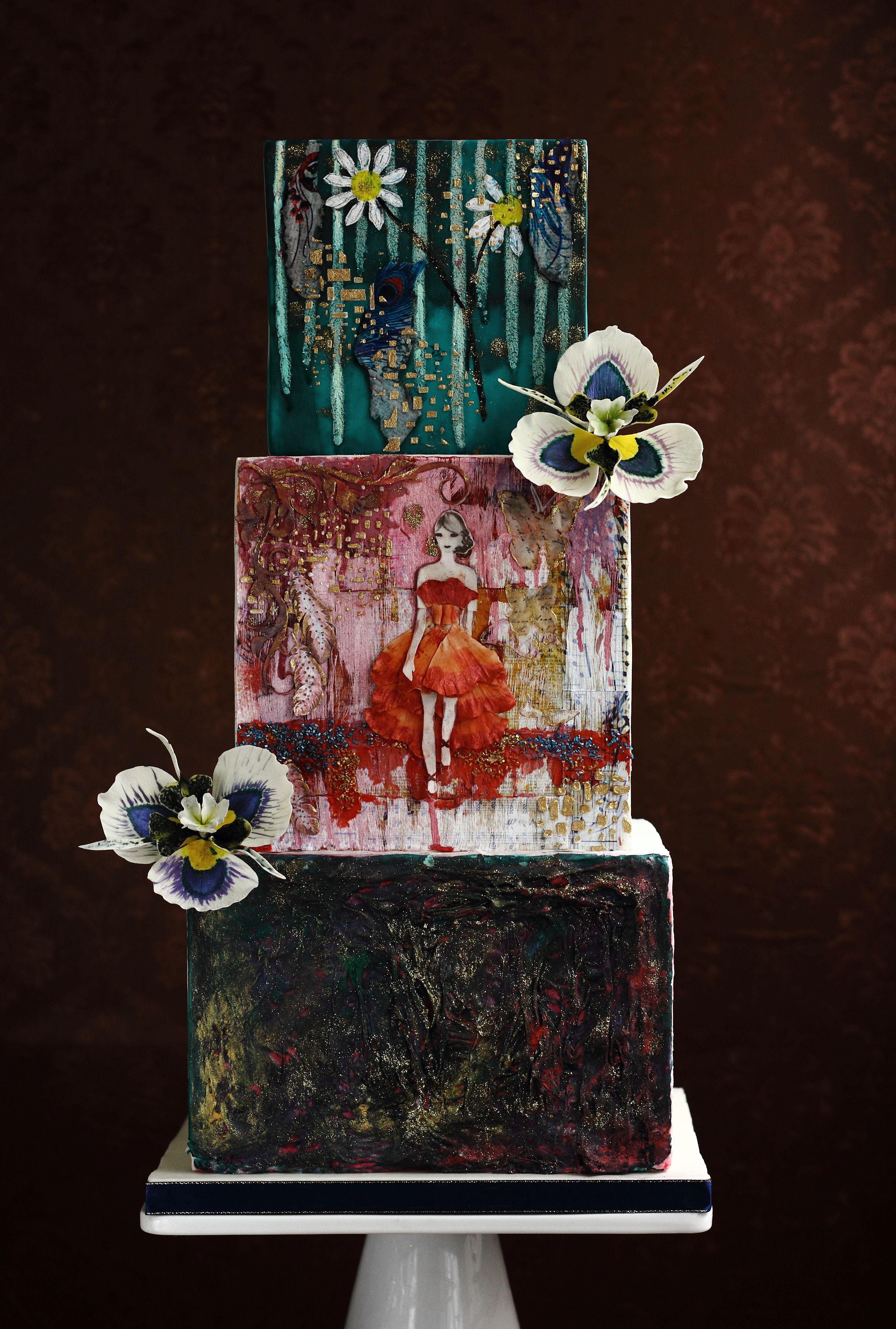 Hand painted buddha themed wedding cake