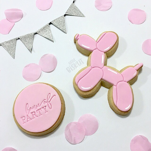 Pink balloon animal cookies
