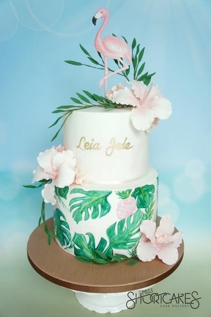 Fondant flamingo and palm tree cake