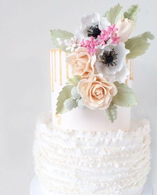 White ruffle wedding with  pastel sugar flowers