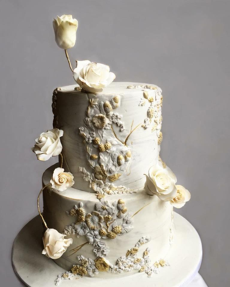 White and gray bas relief textured wedding cake