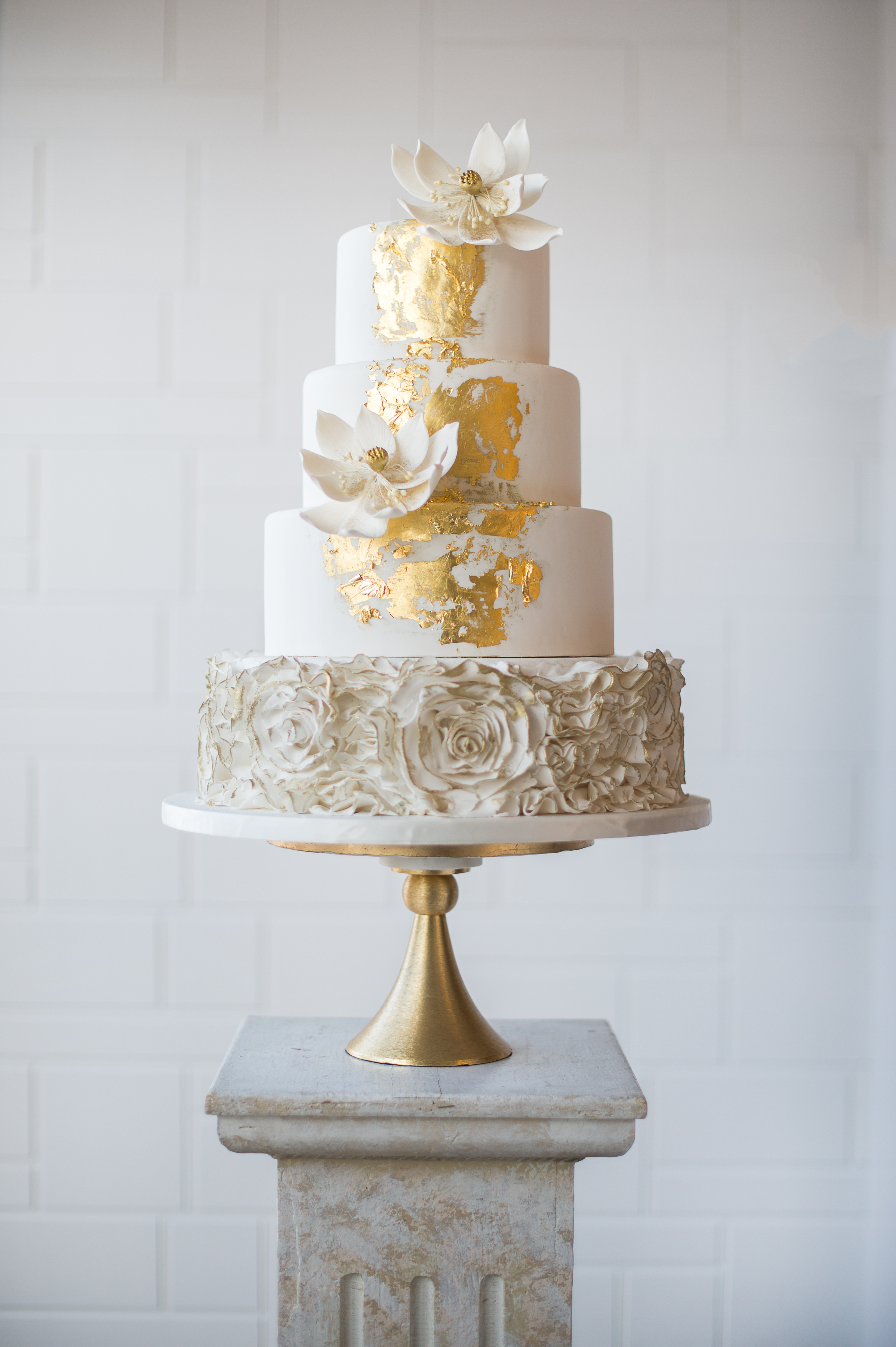 White Wedding with rosettes and golf leaf