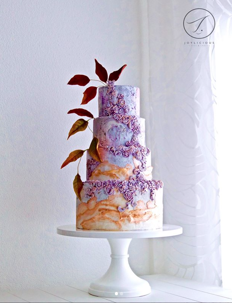 Lavender textured wedding cake with bas relief