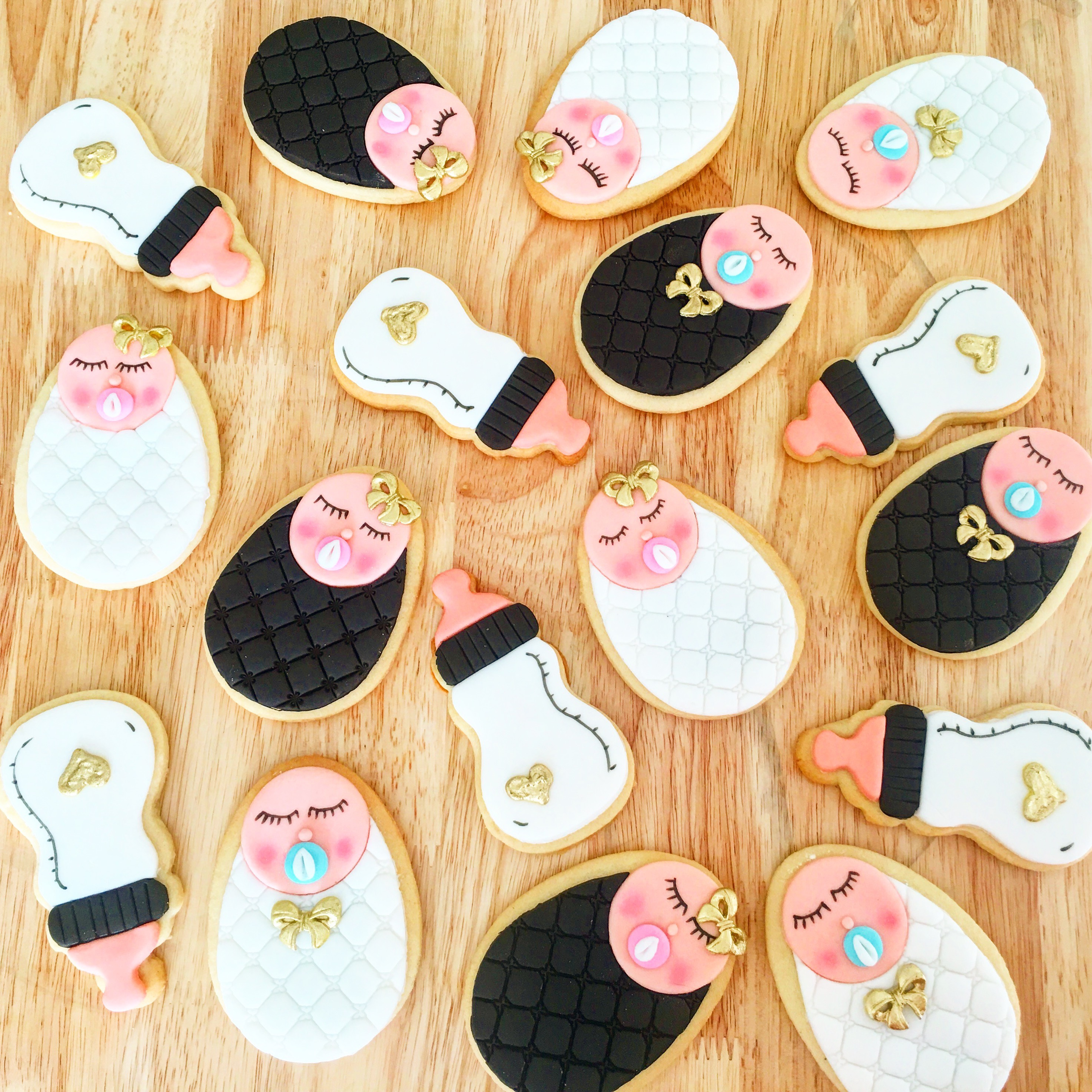 Black white and pink baby shower girl cookies