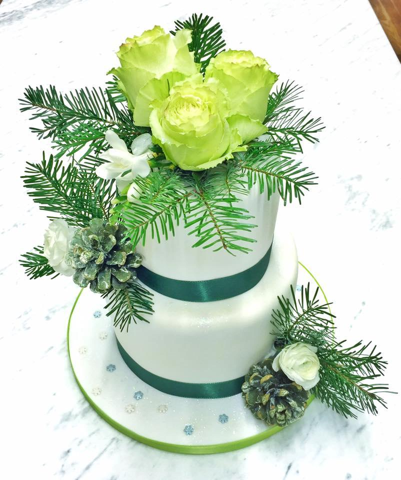 White wedding cake with greenery & sugar flowers